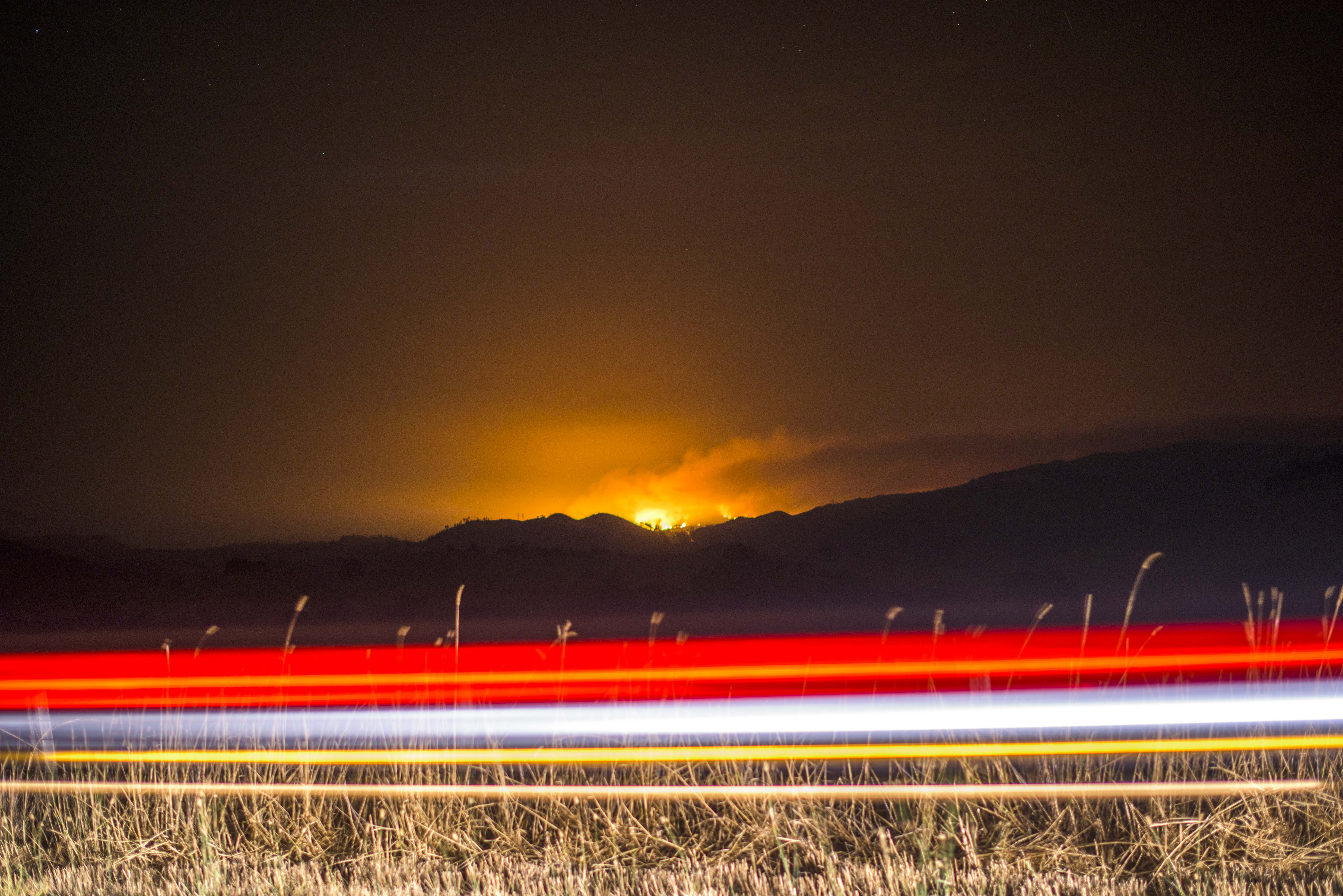 The Valley Fire burns off Highway 128 on Sept. 13, 2015.