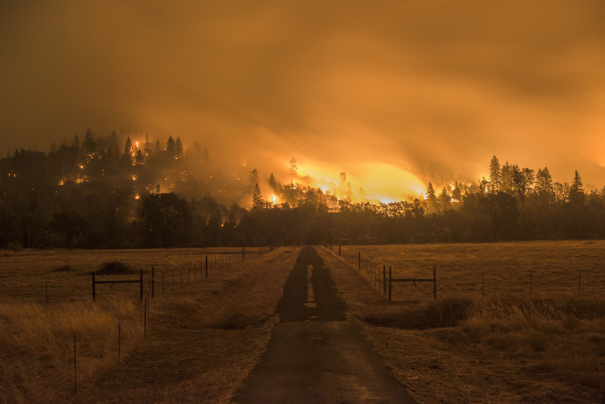 The Valley Fire burns off Highway 29 on Sept. 13, 2015.