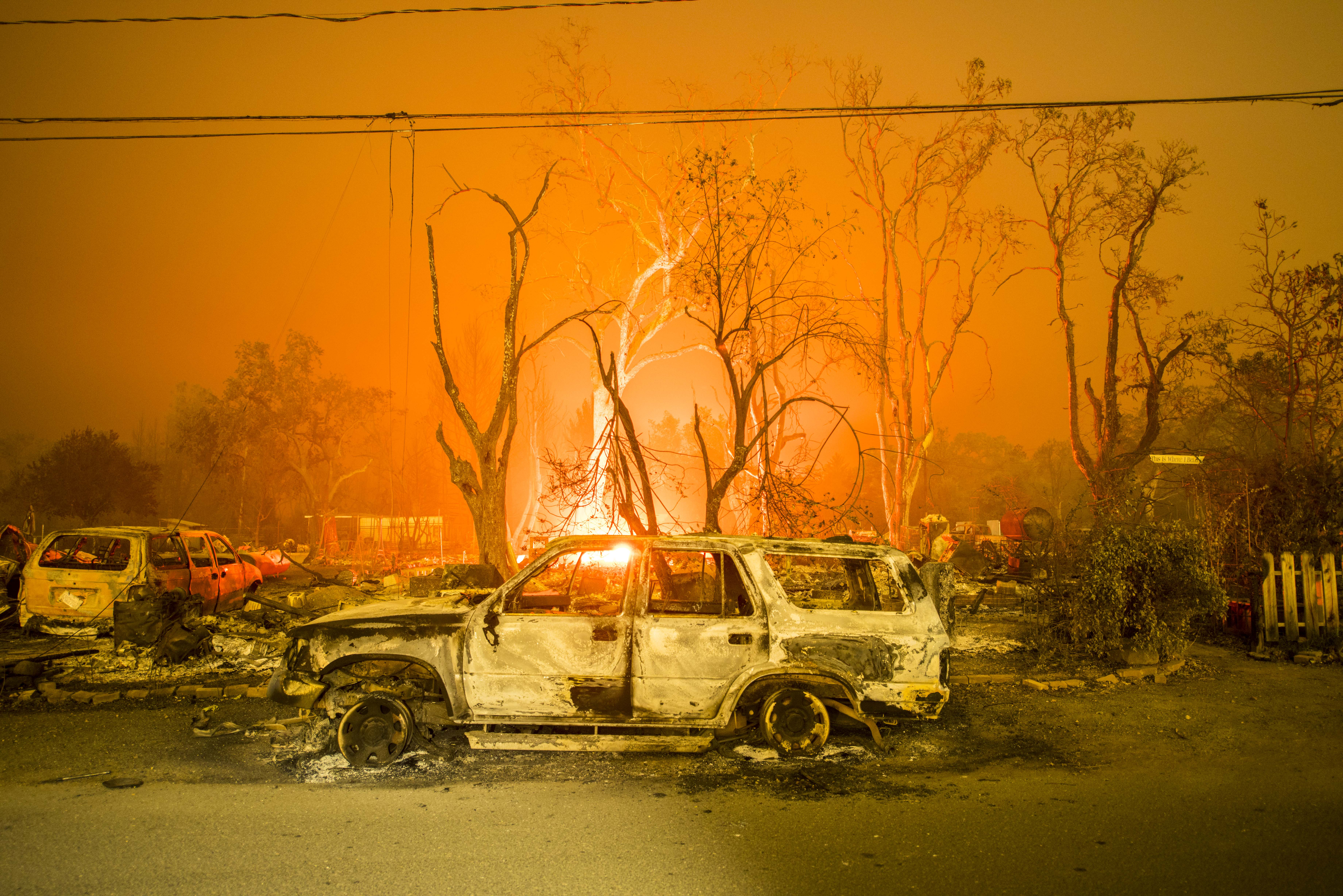A burned out truck sits in front of a destroyed structure on Sept. 13, 2015 in Middletown, Calif.