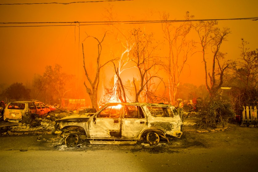 A burned out truck sits in front of a destroyed structure in Middletown, CA Sunday evening. Valley Fire in Lake and Sonoma Counties Sunday September 13th, 2015. As of Sunday evening the fire had burned over 50,000 acres and was 0% contained. The Associated Press reported that at least one person was killed due to the fire.