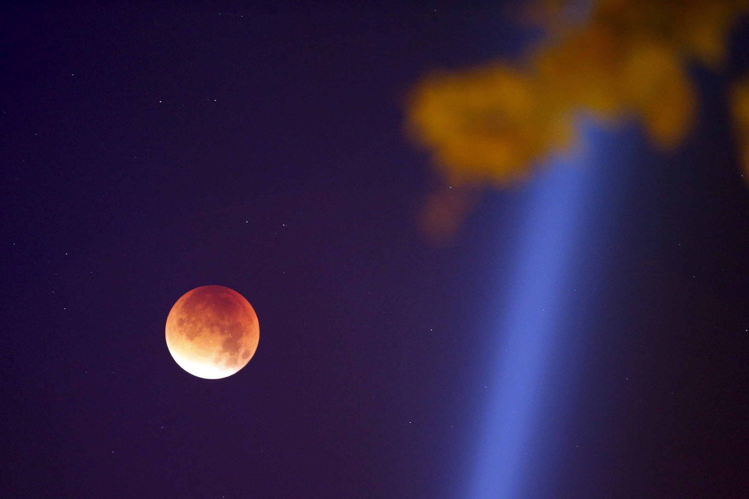 The Supermoon appears red as it is covered by the Earth's shadow during the total lunar eclipse over Paris on Sept. 28, 2015.