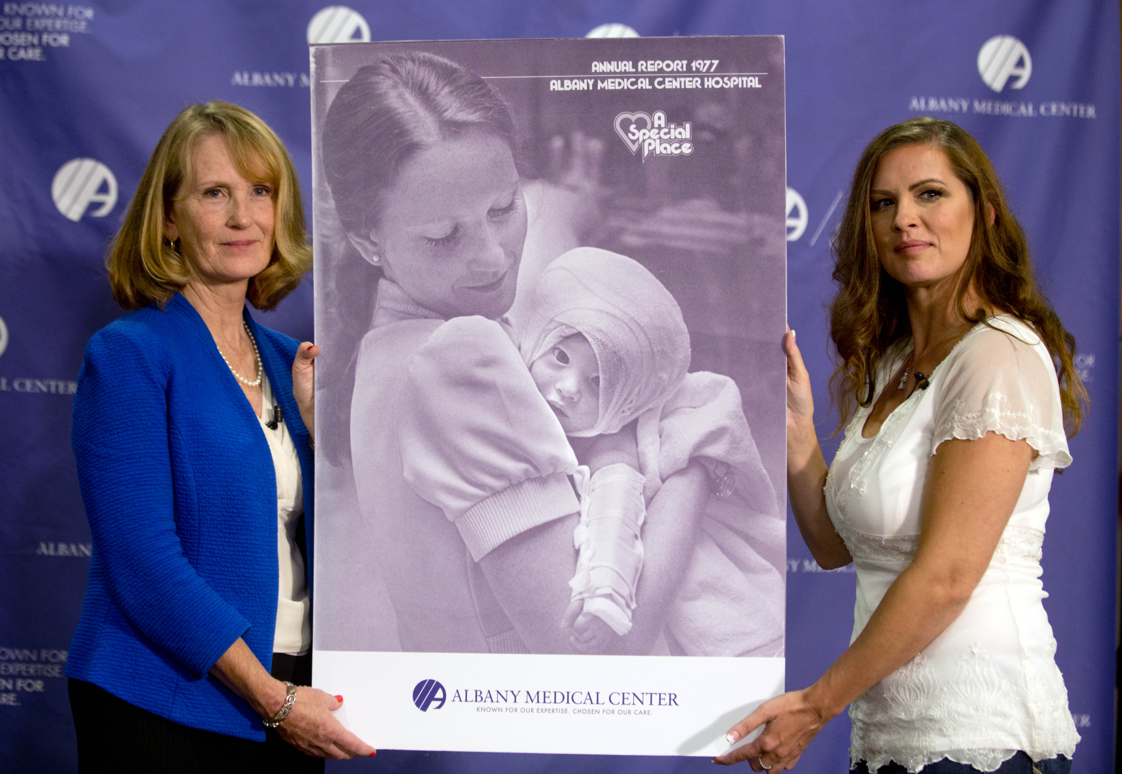 Nurse Susan Berger (L) and Amanda Scarpinati pose with a copy of a 1977 Albany Medical Center annual report during a news conference at Albany Medical Center in Albany, N.Y. on Sept. 29, 2015.