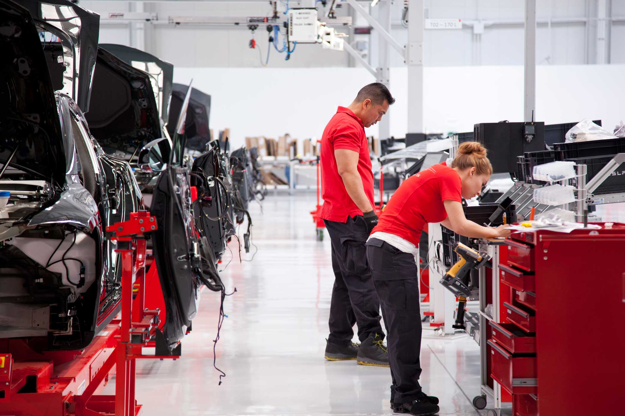 Workers on the assembly line at the Tesla Factory in Fremont, Calif.