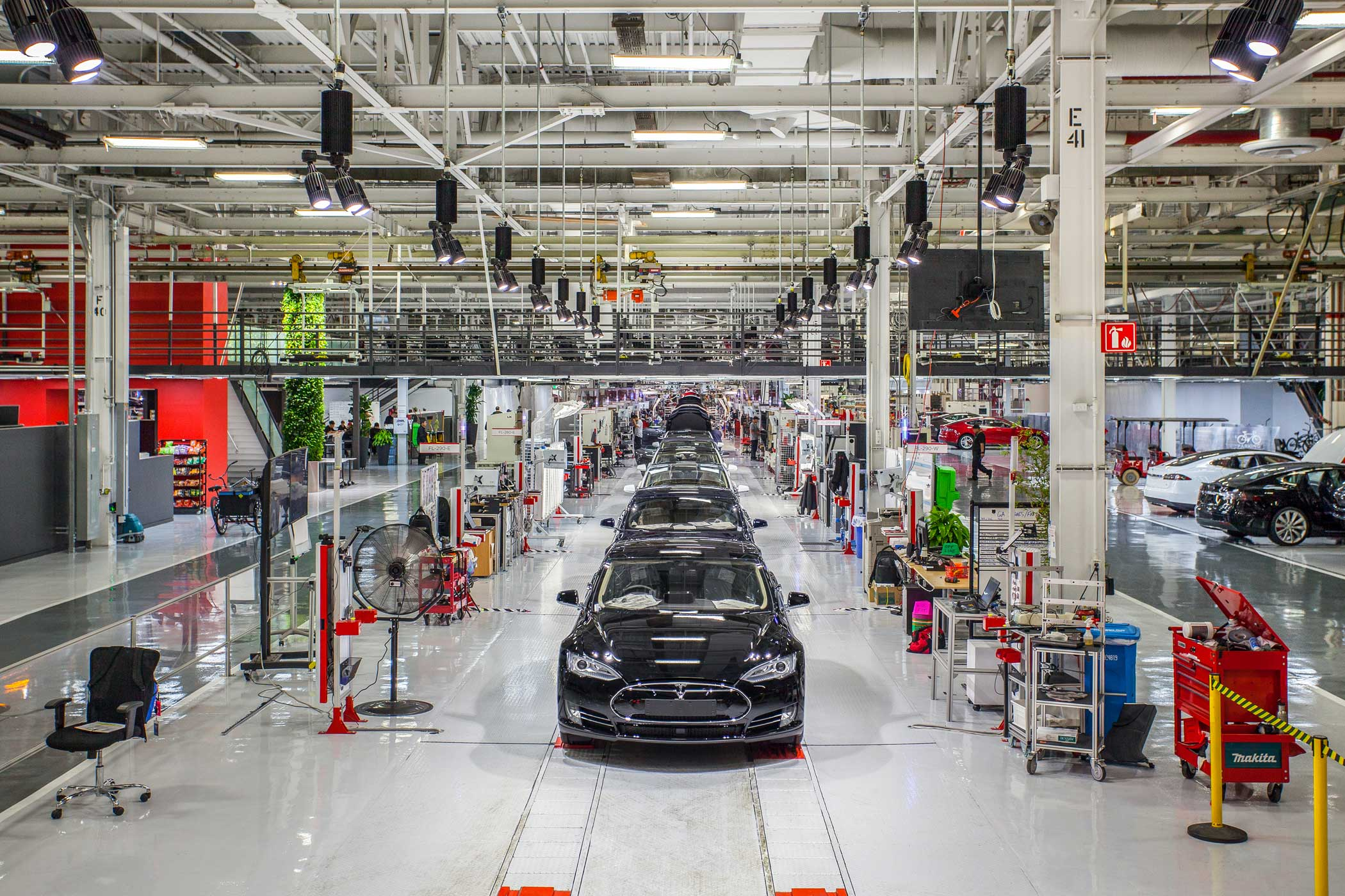 Model S cars near the end of the assembly line at the Tesla Factory in Fremont, Calif.