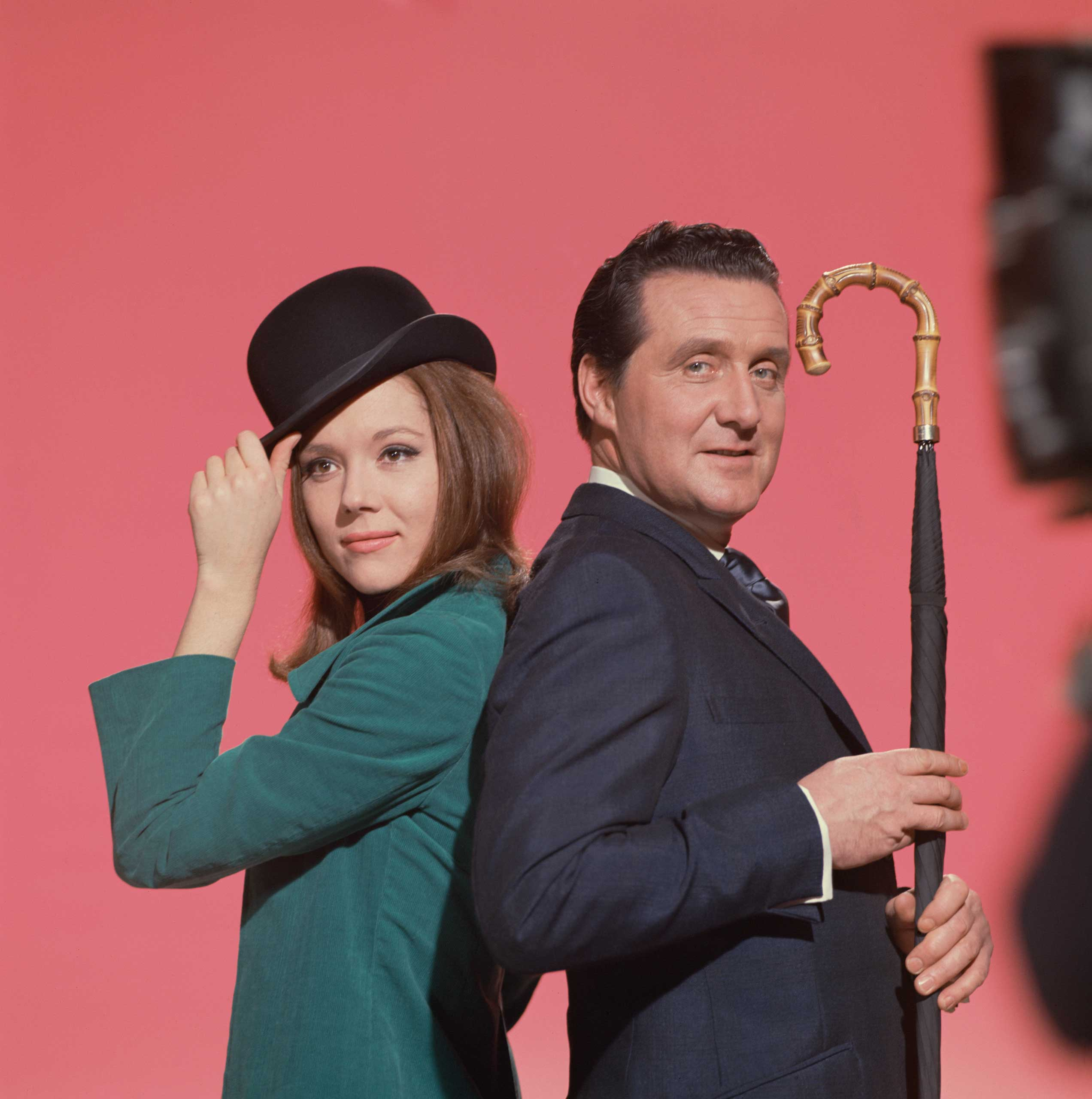 <b>The Avengers (Diana Rigg &amp; Patrick Macnee)</b>                                   Photographed for TV Times in 1964.                                   An iconic shot taken when Diana Rigg took over from Honor Blackman in the 'spy-fi' classic. The name Emma Peel derived from the writers' attempts to create a character with Man Appeal.