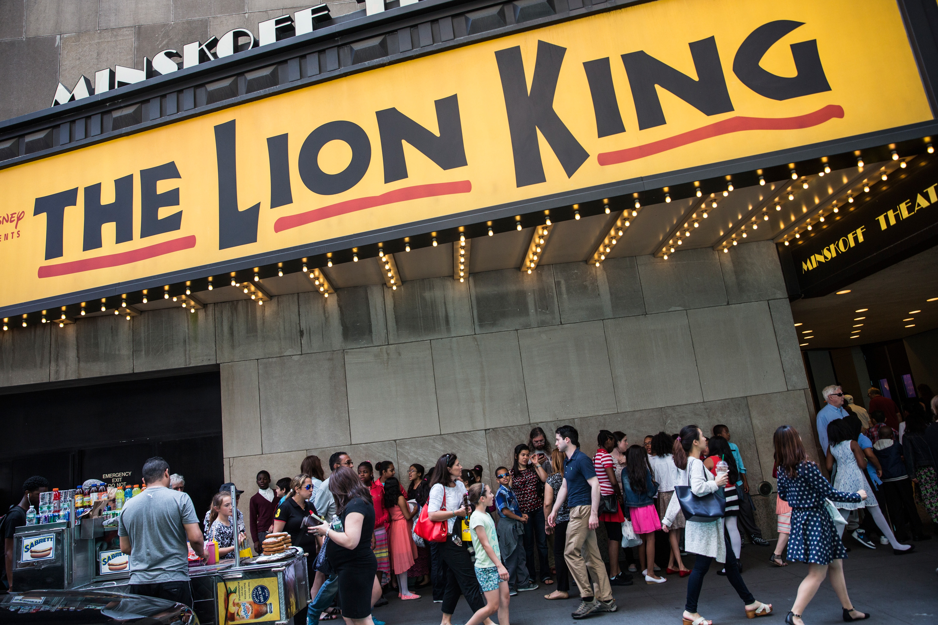 People wait in line to see the matinee show of The Lion King on May 27, 2015 in New York City.