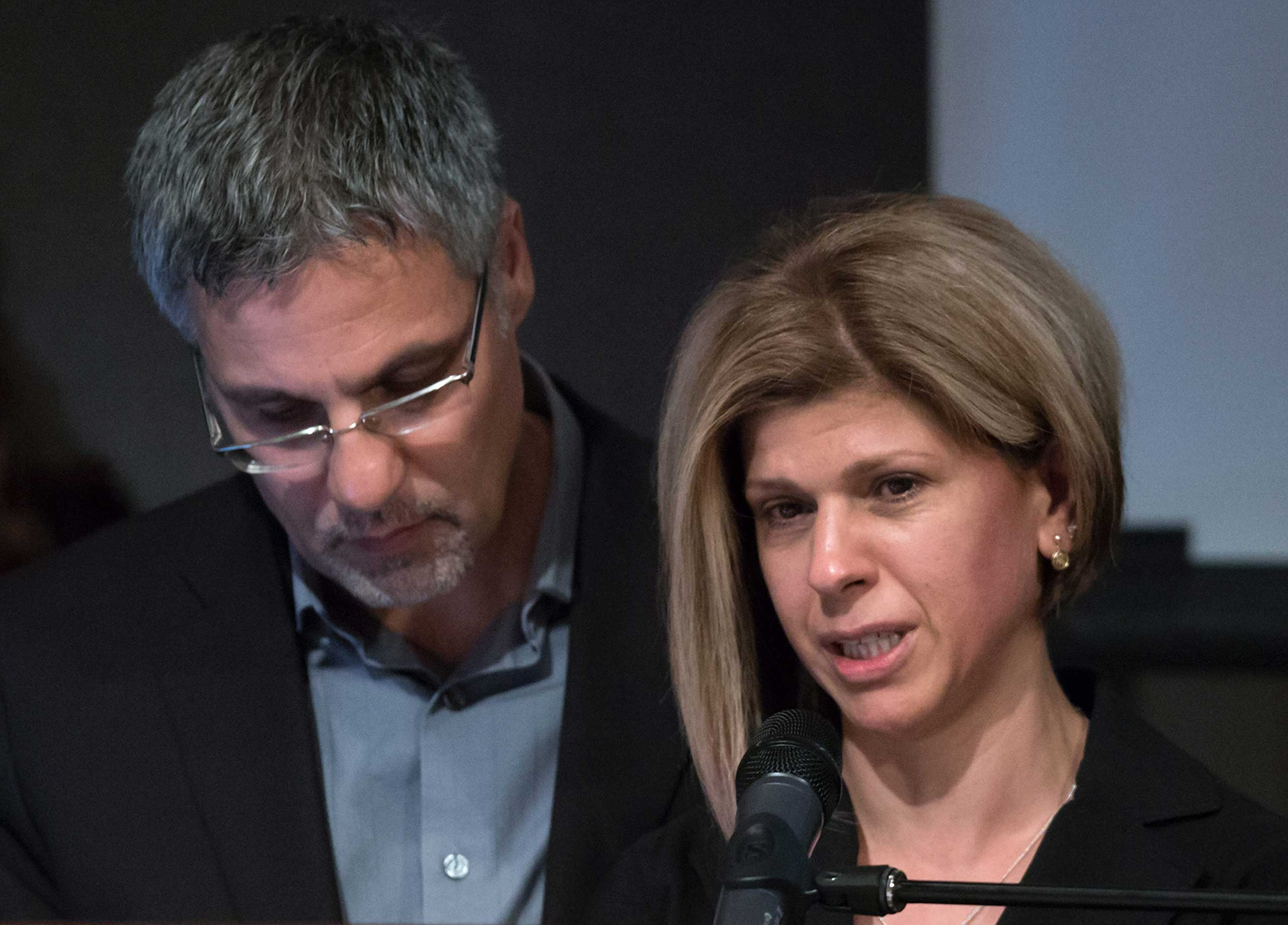 Tima Kurdi, right, aunt of late brothers Alan and Ghalib Kurdi, is comforted by her husband, Rocco Logozzo, as she speaks during a memorial service for the boys and their mother in Vancouver, British Columbia, Canada on, Sept. 5, 2015.