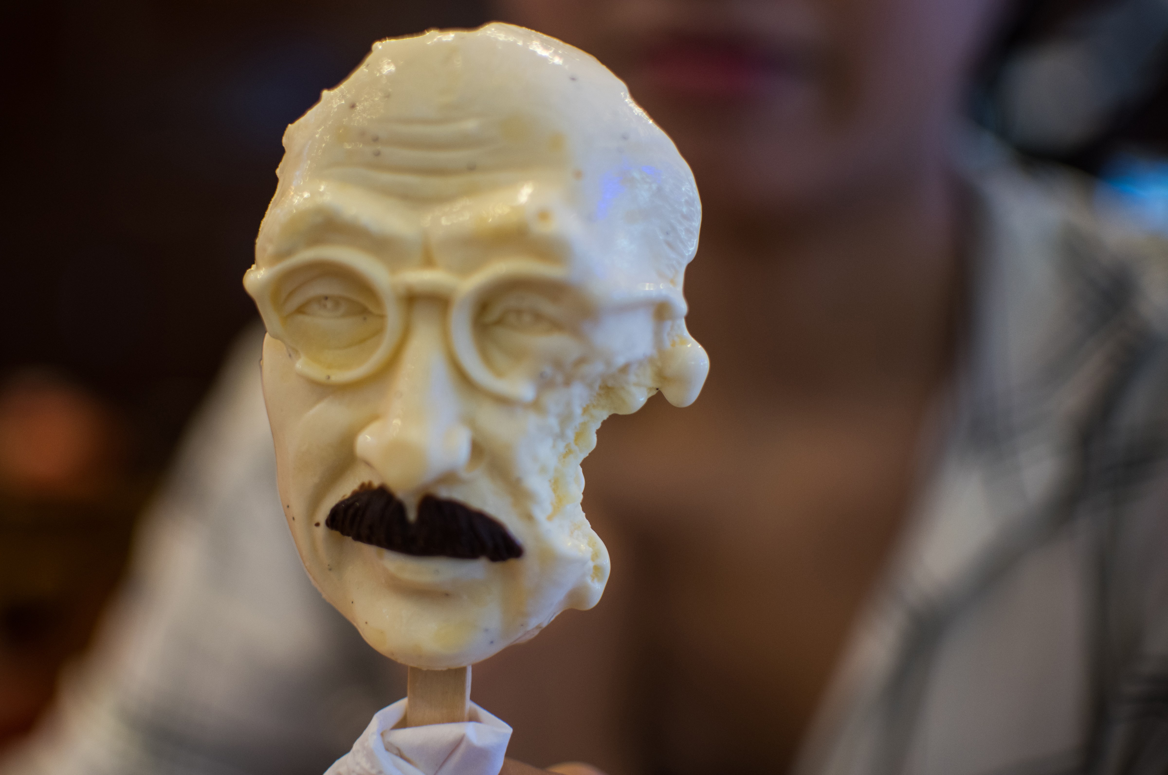 A woman sells an ice cream in the shape of executed Japanese war criminal Hideki Tojo at an ice cream store in Shanghai on Sept. 2, 2015