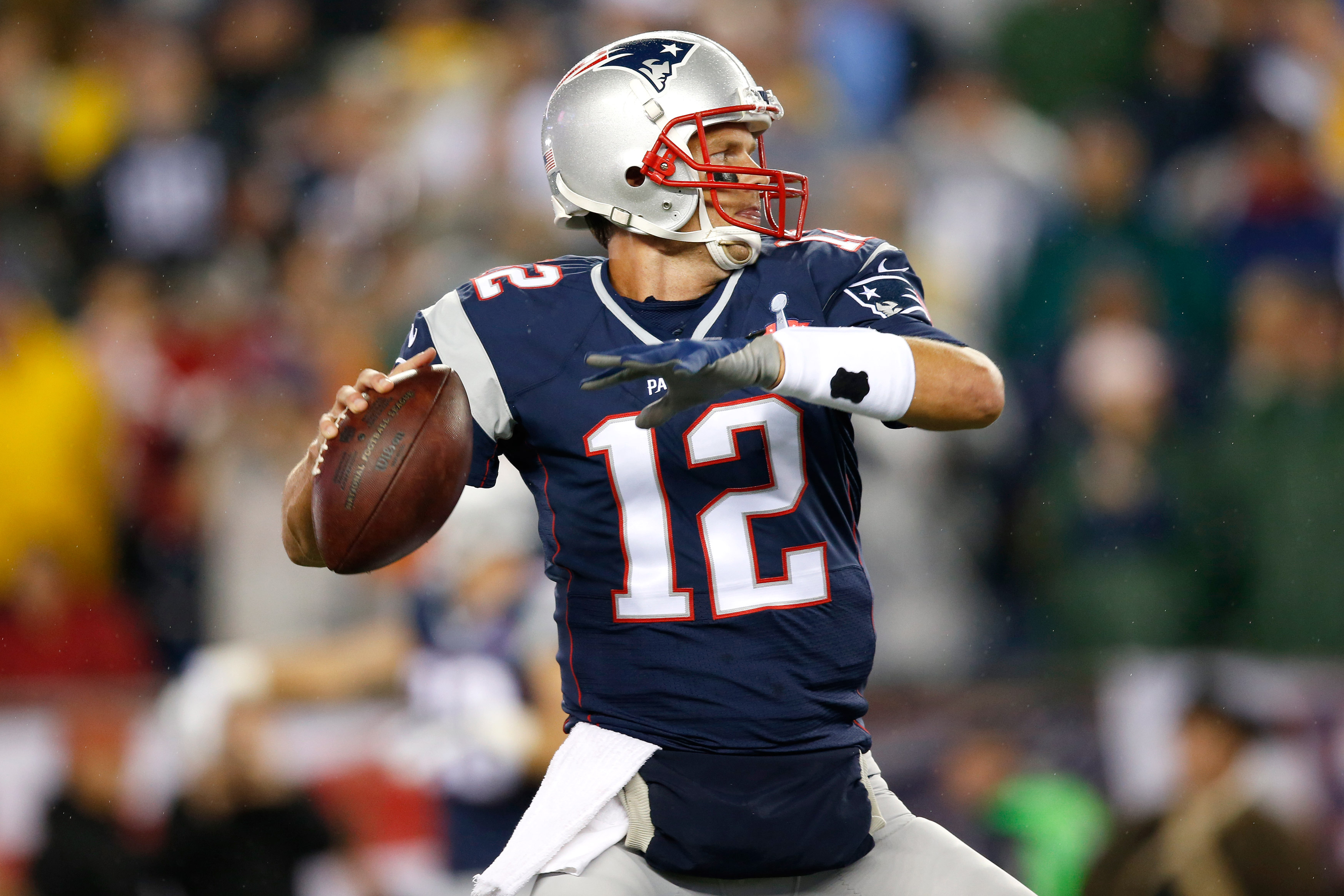 New England Patriots quarterback Tom Brady throws the ball against the Pittsburgh Steelers defense during the NFL football kickoff game at Gillette Stadium on Sept. 10, 2015 in Foxborough, Mass.