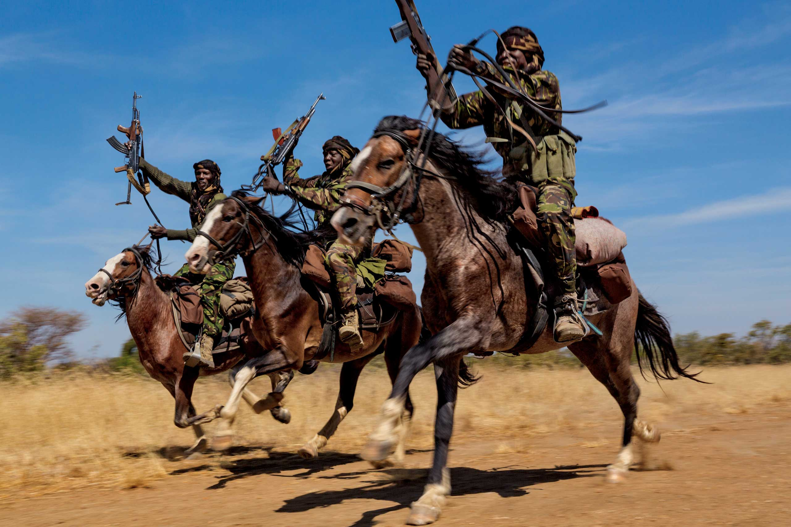 From the September issue of National Geographic magazine: Tracking Ivory:  Terror in Africa Rangers practice their riding skills at Zakouma National Park, in Chad. The park has four mounted ranger teams because horses are the only way to effectively patrol during the wet season, when the elephants head to drier land outside the park.