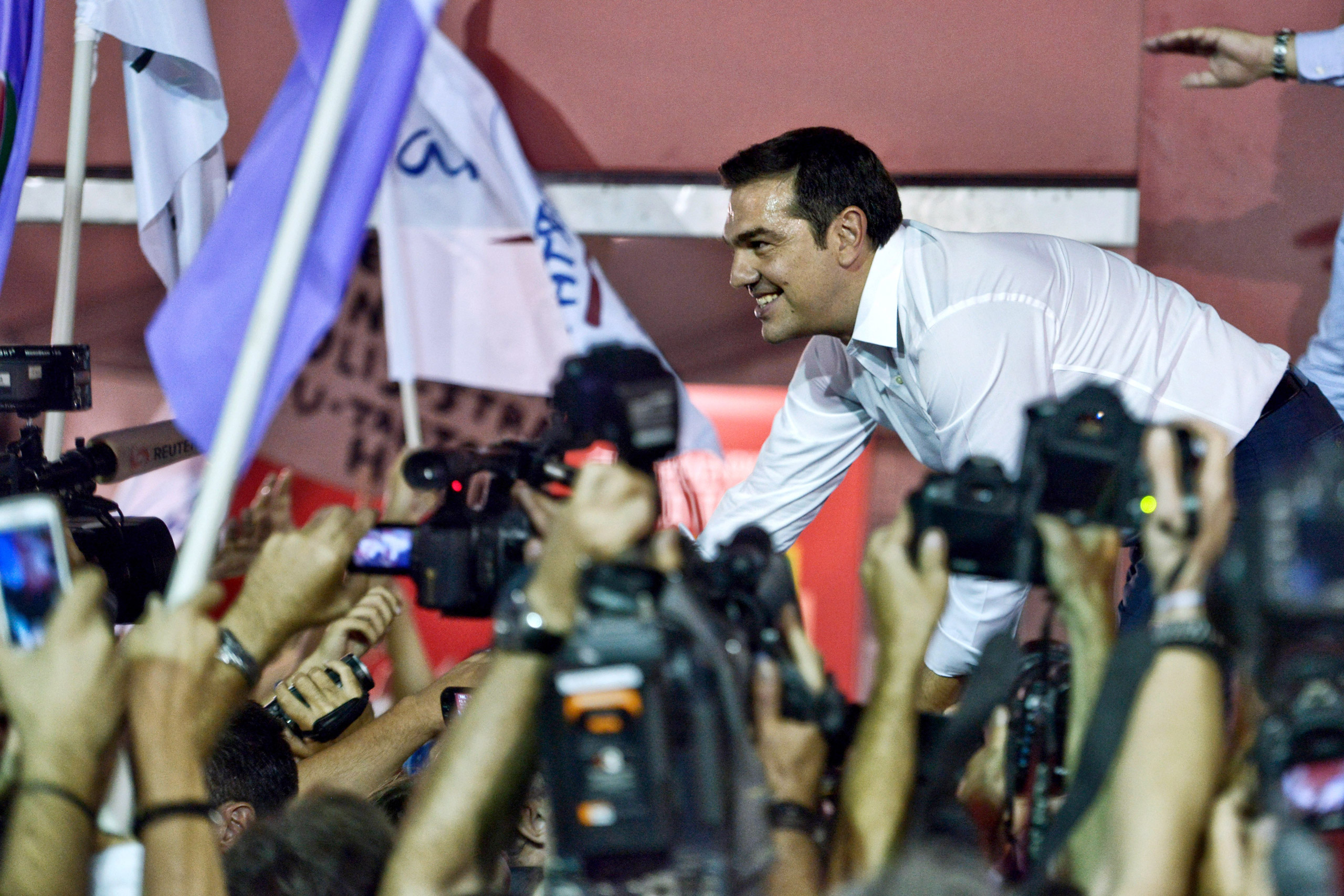 Former Greek prime minister and leader of leftist Syriza party Alexis Tsipras address supporters after winning the general election in Athens on Sept. 20, 2015.