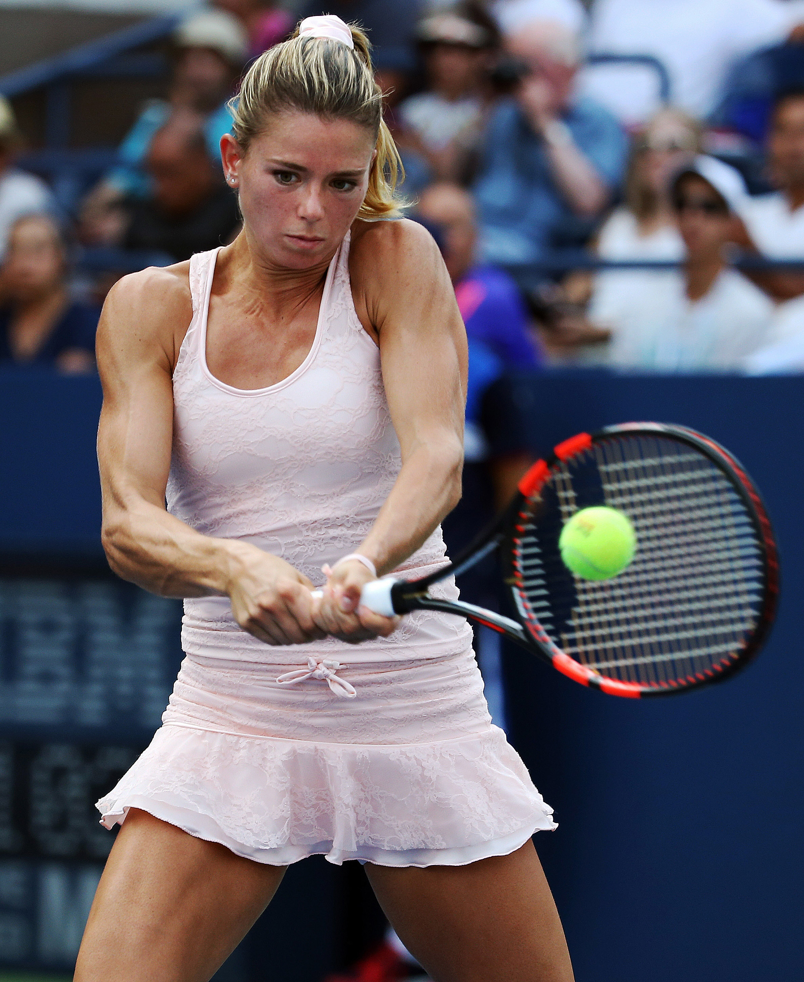 Camila Giorgi, of Italy, returns a shot to Sabine Lisicki, of Germany, during the second round of the U.S. Open in New York on Sept. 3, 2015,