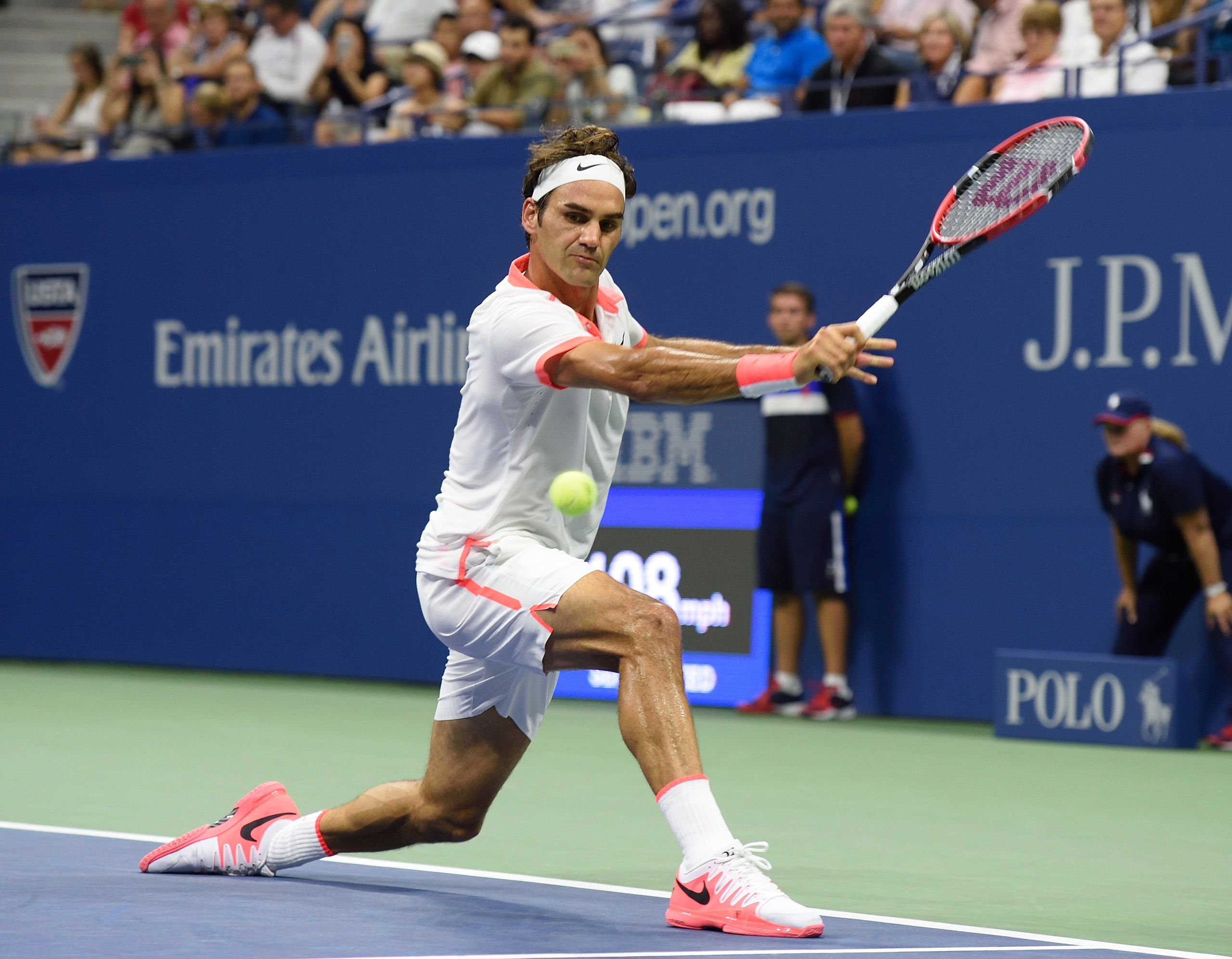 Roger Federer of Switzerland hits a return to Steve Darcis of Belgium during the men's singles round two match on Sept. 3, 2015.