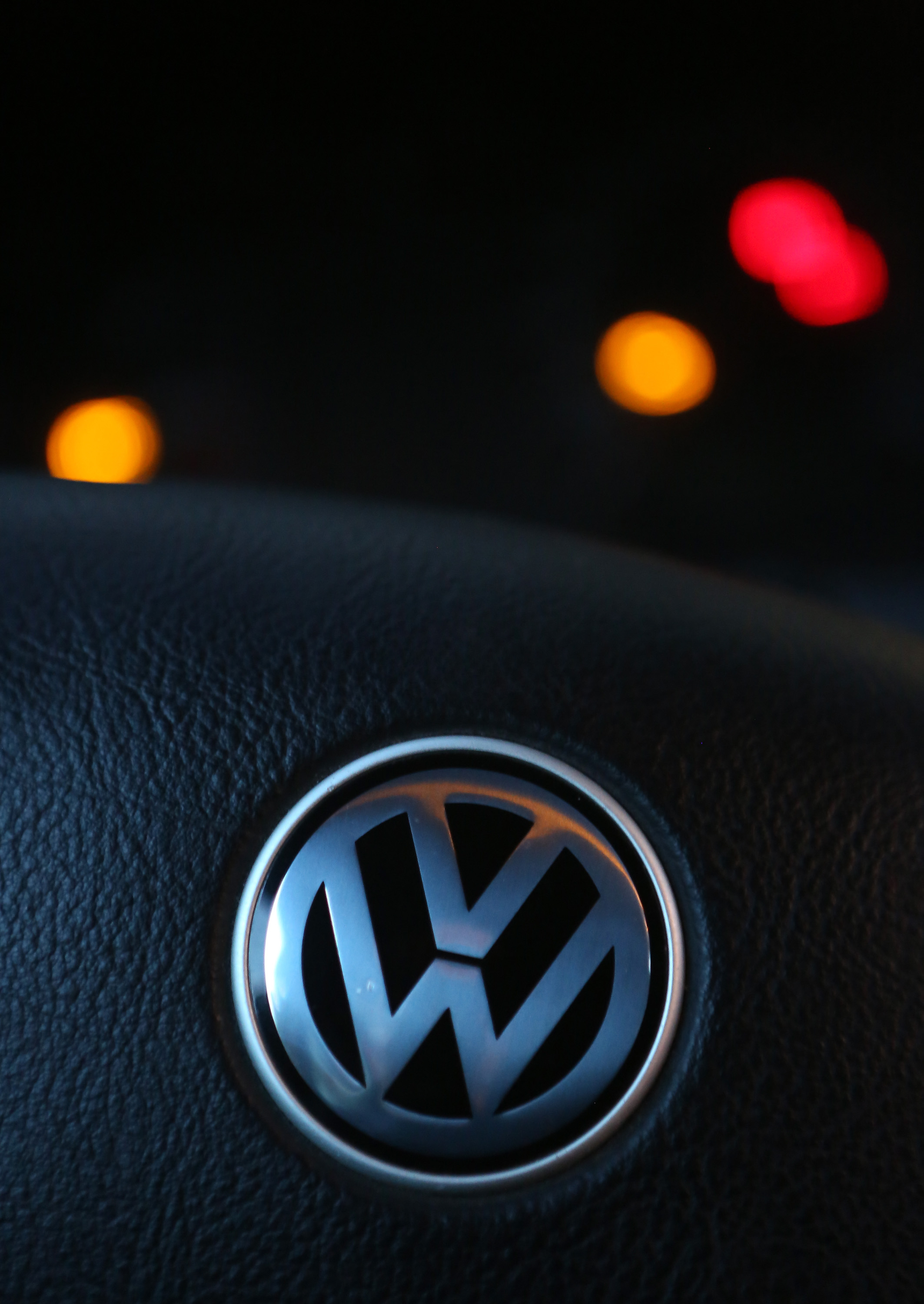 A Volkswagen (VW) logo is seen on the steering wheel of one of the Volkswagen cars in Berlin on Sept. 18, 2015.
