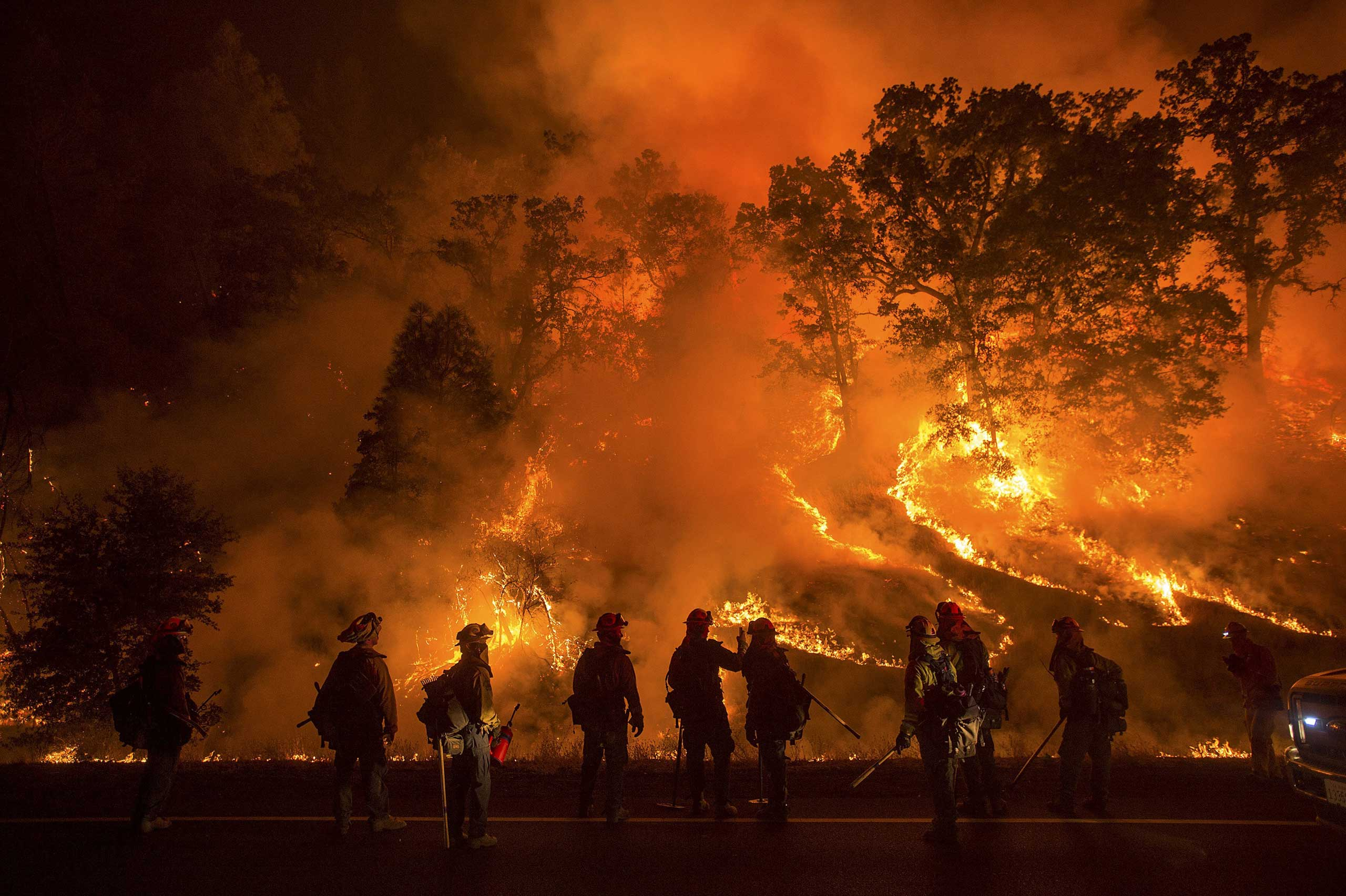 Flames from the Valley Fire cover a hillside along Highway 29 in Lower Lake, California September 13, 2015.