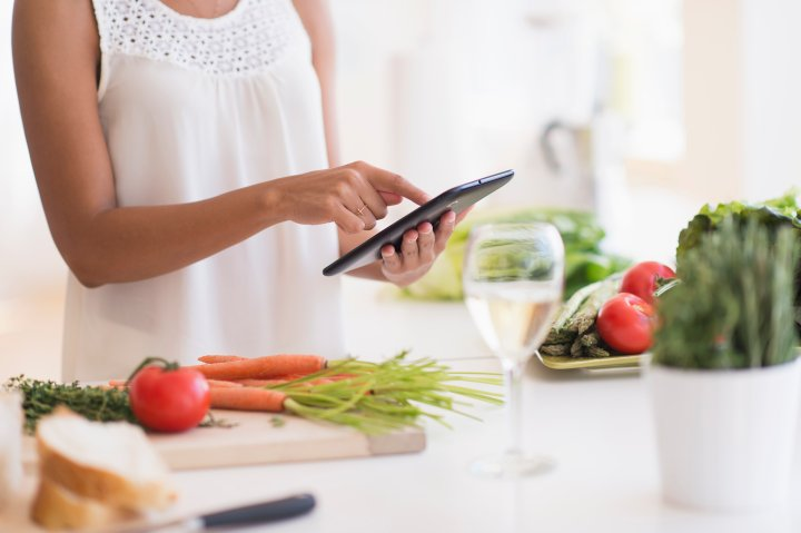 woman-kitchen-cooking-tablet