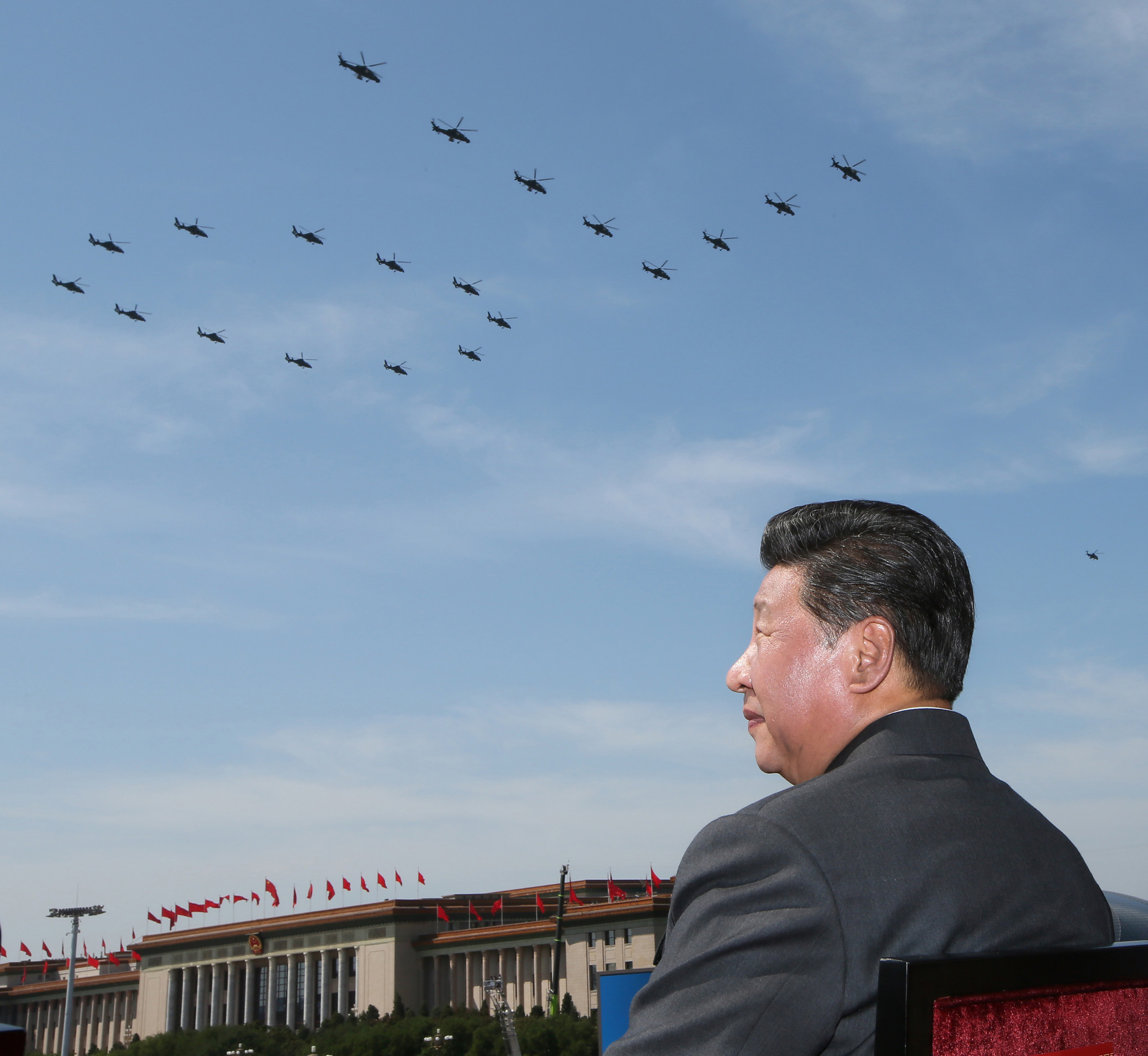 Chinese leader Xi Jinping watches a helicopter fly past, part of a big military parade on Sept. 3 at Beijing's historic Tiananmen Square.