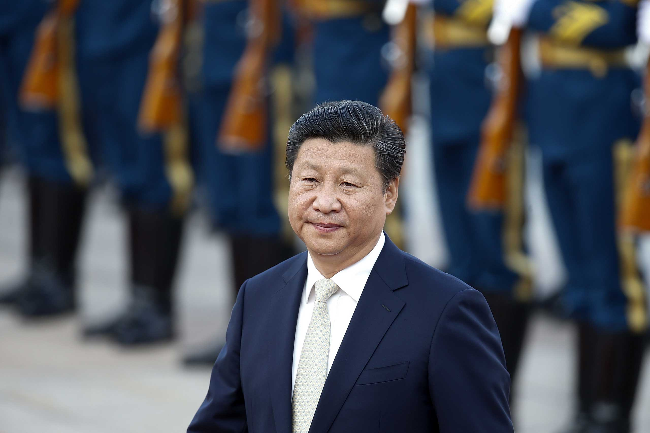 Chinese President Xi Jinping accompanies Mauritania's President Mohamed Ould Abdel Aziz (not pictured) to view an honour guard during a welcoming ceremony outside the Great Hall of the People in Beijing, on Sept. 14, 2015