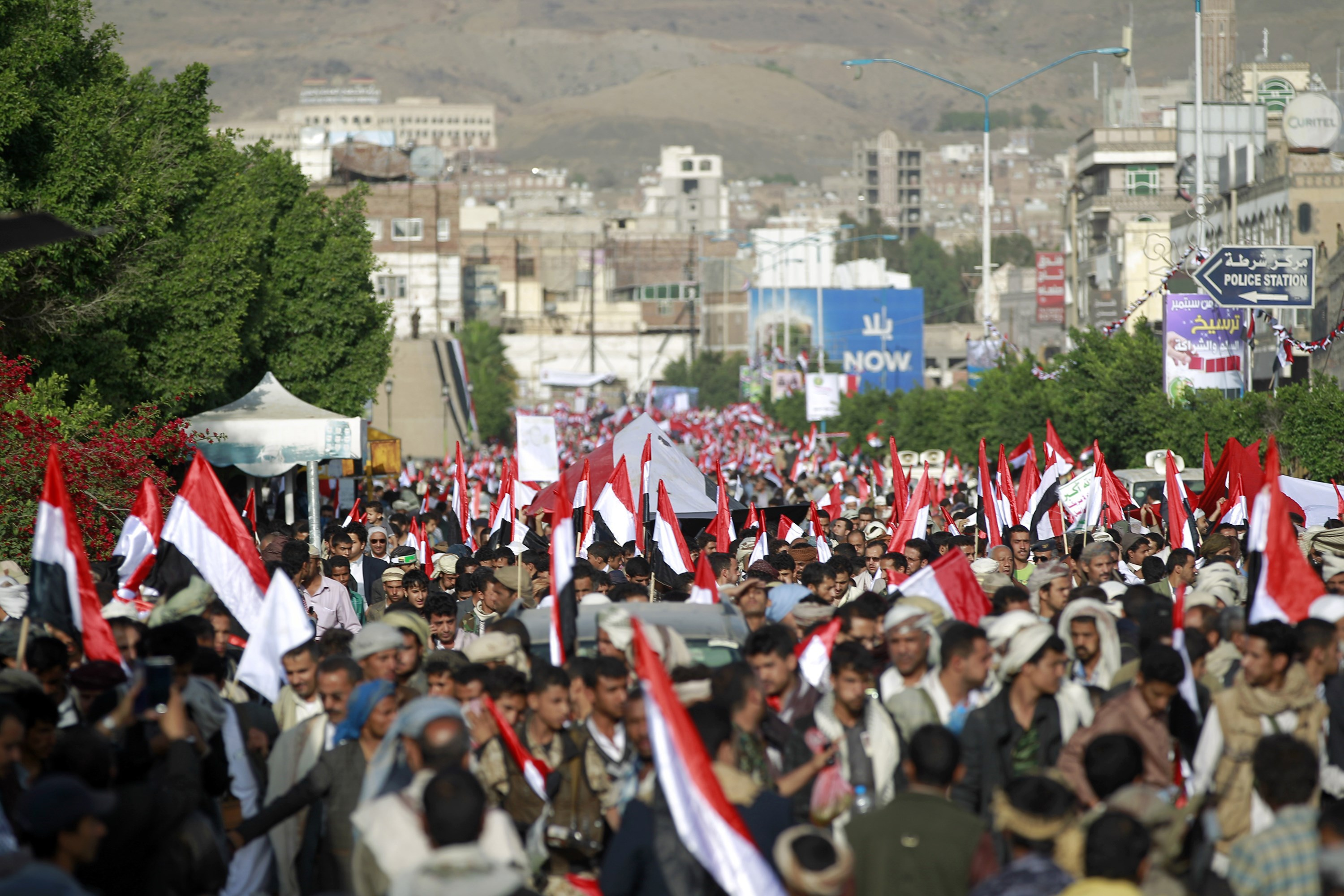Yemeni supporters of the Shiite Huthi rebel movement hold national flags in the capital Sanaa on Sept. 21, 2015.