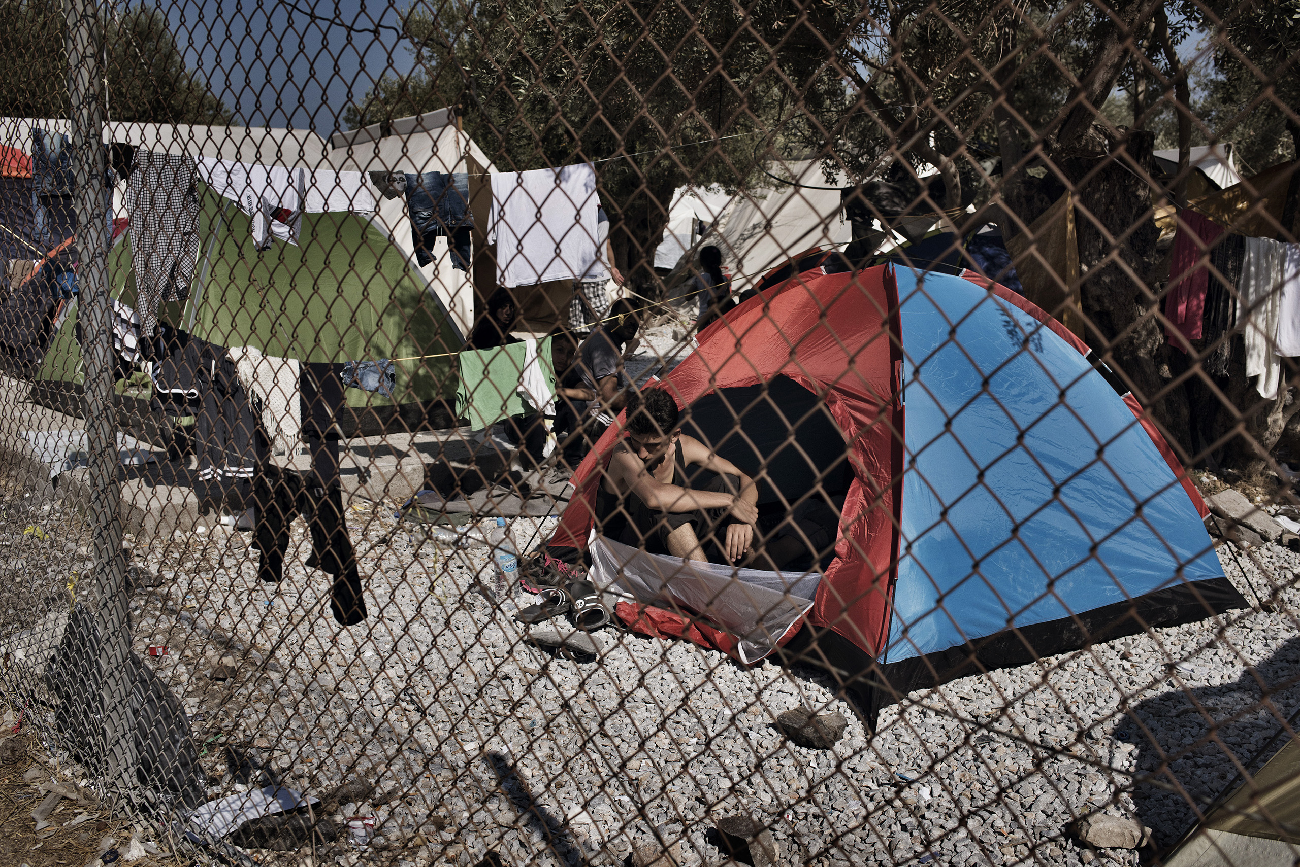 A Syrian migrant rests at a hastily built camp for asylum seekers on the Greek island of Lesbos. Sept. 4, 2015.