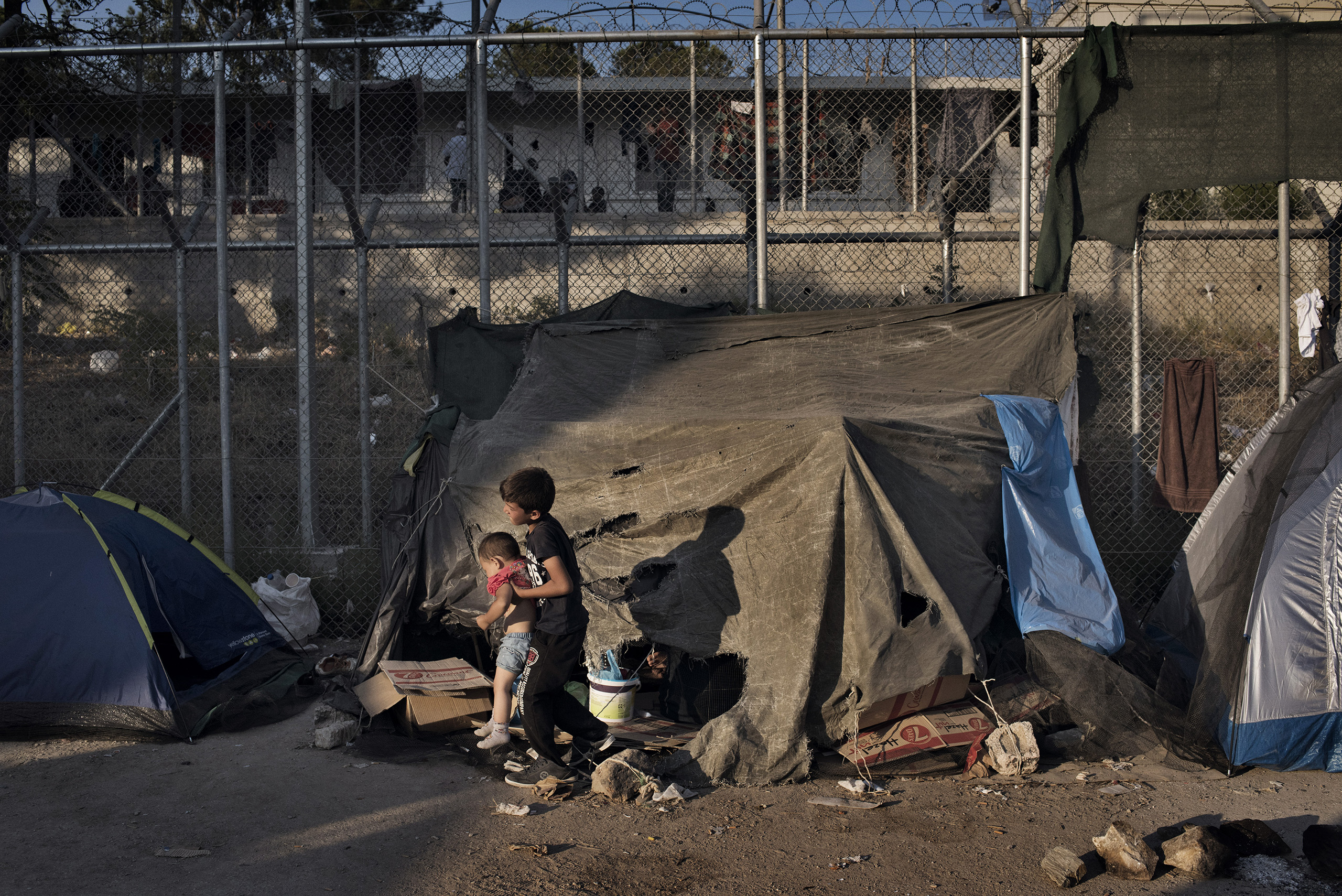 Tents full of migrants stand outside a detention and processing center for asylum seekers on the Greek island of Lesbos, one of the most crowded and volatile outposts for the unprecedented wave of migrants coming to the European Union from conflict zones across the Muslim world.