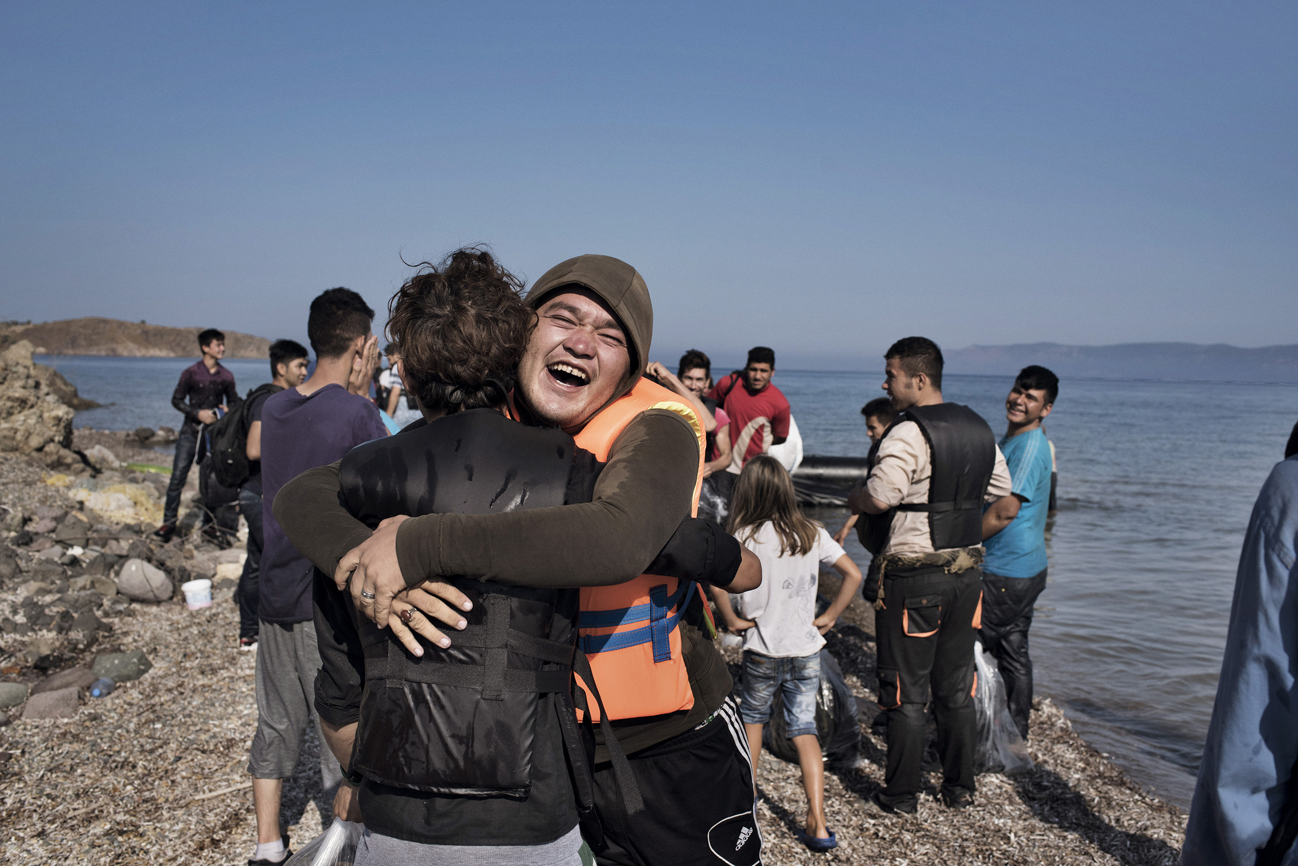 Migrants from Afghanistan rejoice after crossing safely by boat from Turkey to the Greek island of Lesbos, the first piece of European land they reached on their journey to claim asylum in Germany and other wealthy European nations.