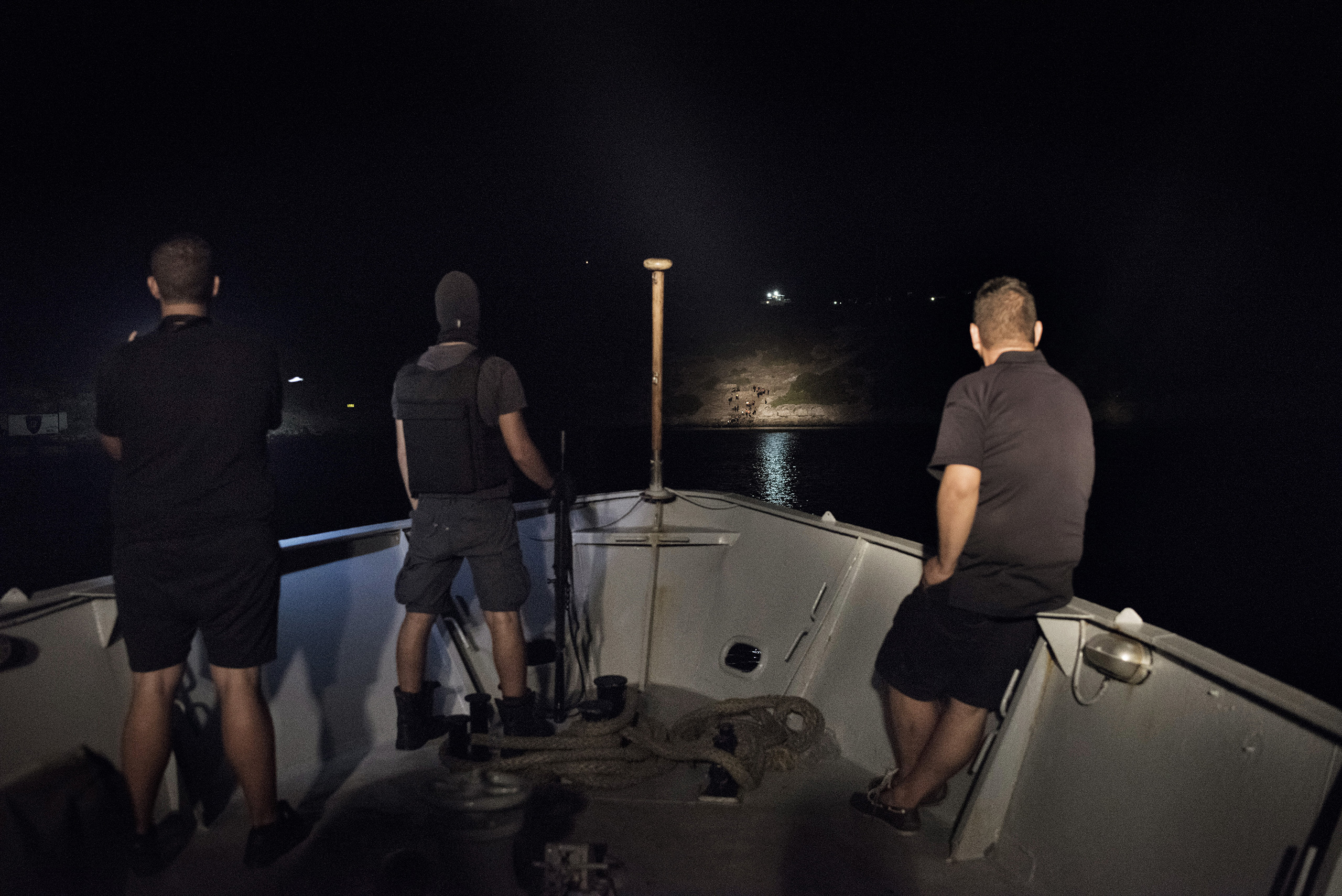Greek coast guards spot a group of migrants who have just landed on the island of Farmakonisi, a Greek naval outpost near the border with Turkey. Sept. 7, 2015.