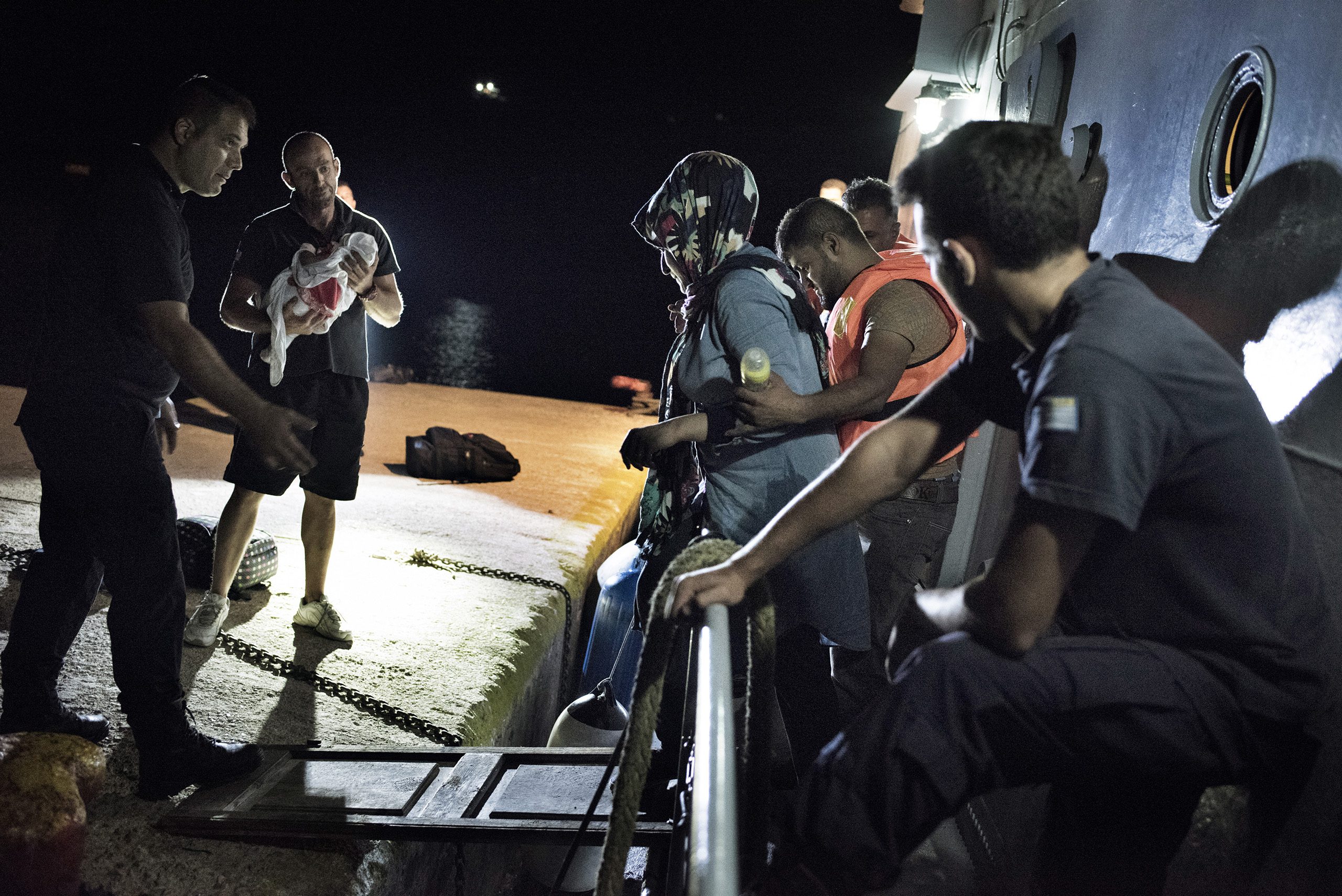 Greek coast guards bring a group of Syrian migrants onto the island of Farmakonisi, a Greek naval outpost near the border with Turkey. Sept. 7, 2015.