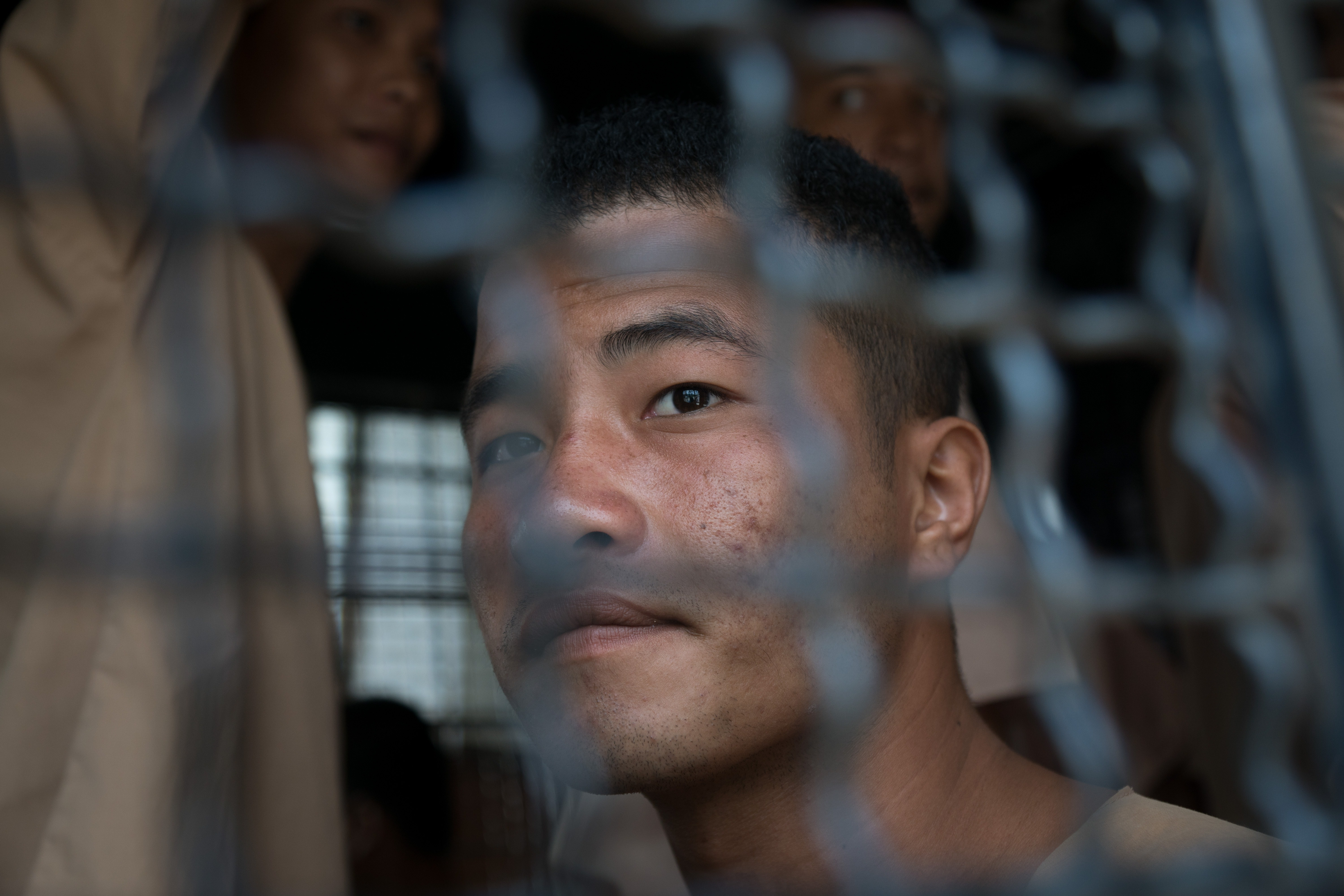 Myanmar national Zaw Lin looks on as he arrives in a prison transport van outside Koh Samui court on the Thai resort island of Koh Samui on July 9, 2015