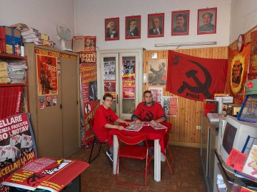 Party members Christina (left) and Mattia (right) in the PMLI Sede di Milano office in Milan, Italy.
