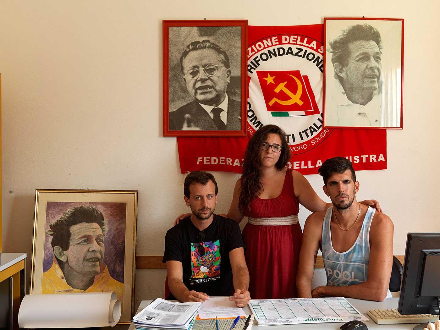 Partito Rifundazione Comunista (PRC) Press Officer Francesca Orazzini (middle) with part-time secretaries Davide Samuele Franchi  (left) and Alessio Flamnia (right) in Rosignano Solvay, Italy.