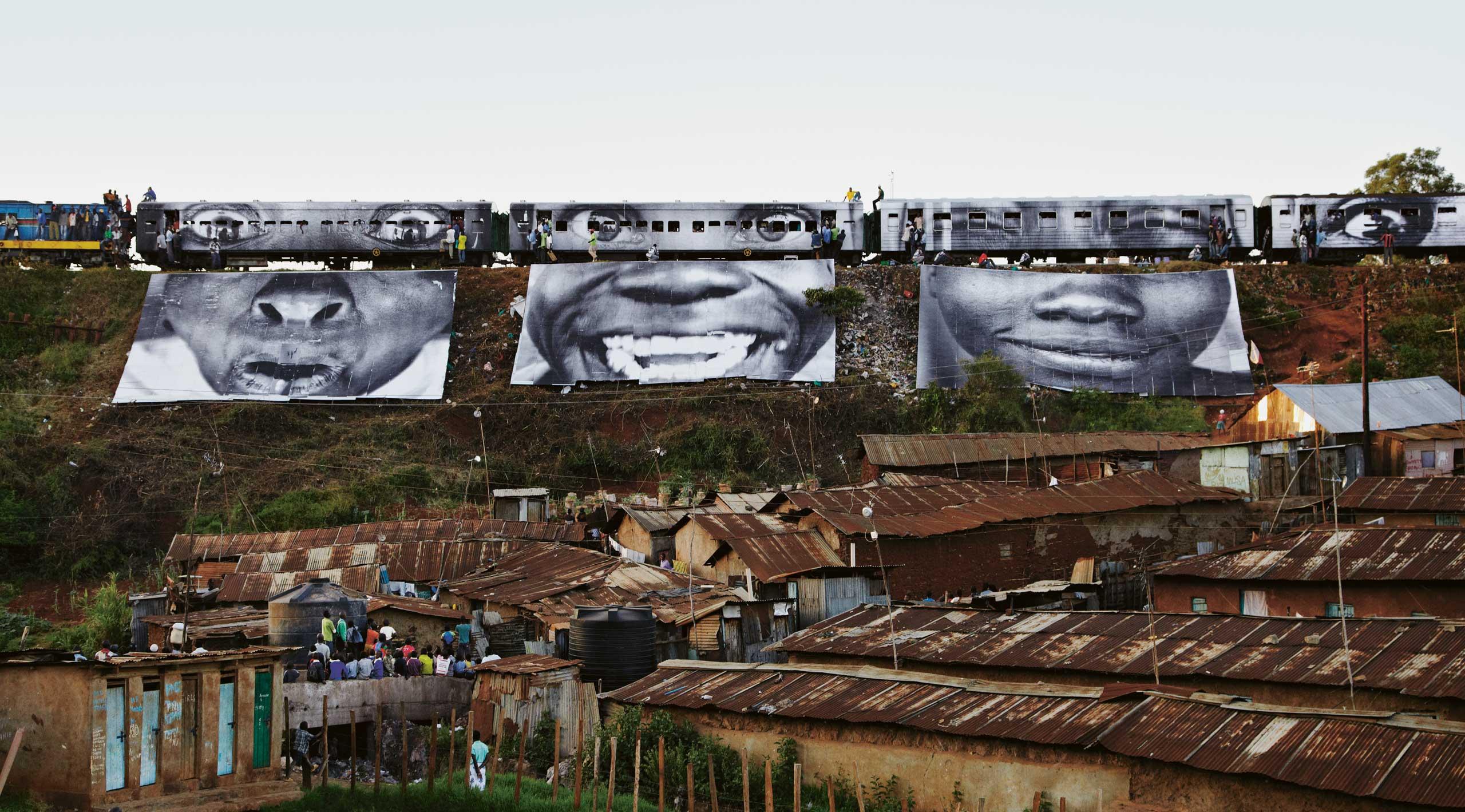Women are Heroes: Train passing, Kibera, Kenya, 2009.