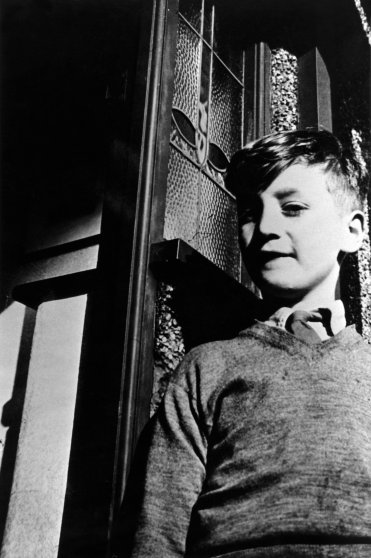 John Lennon at home in Liverpool during his schooldays, circa 1950.