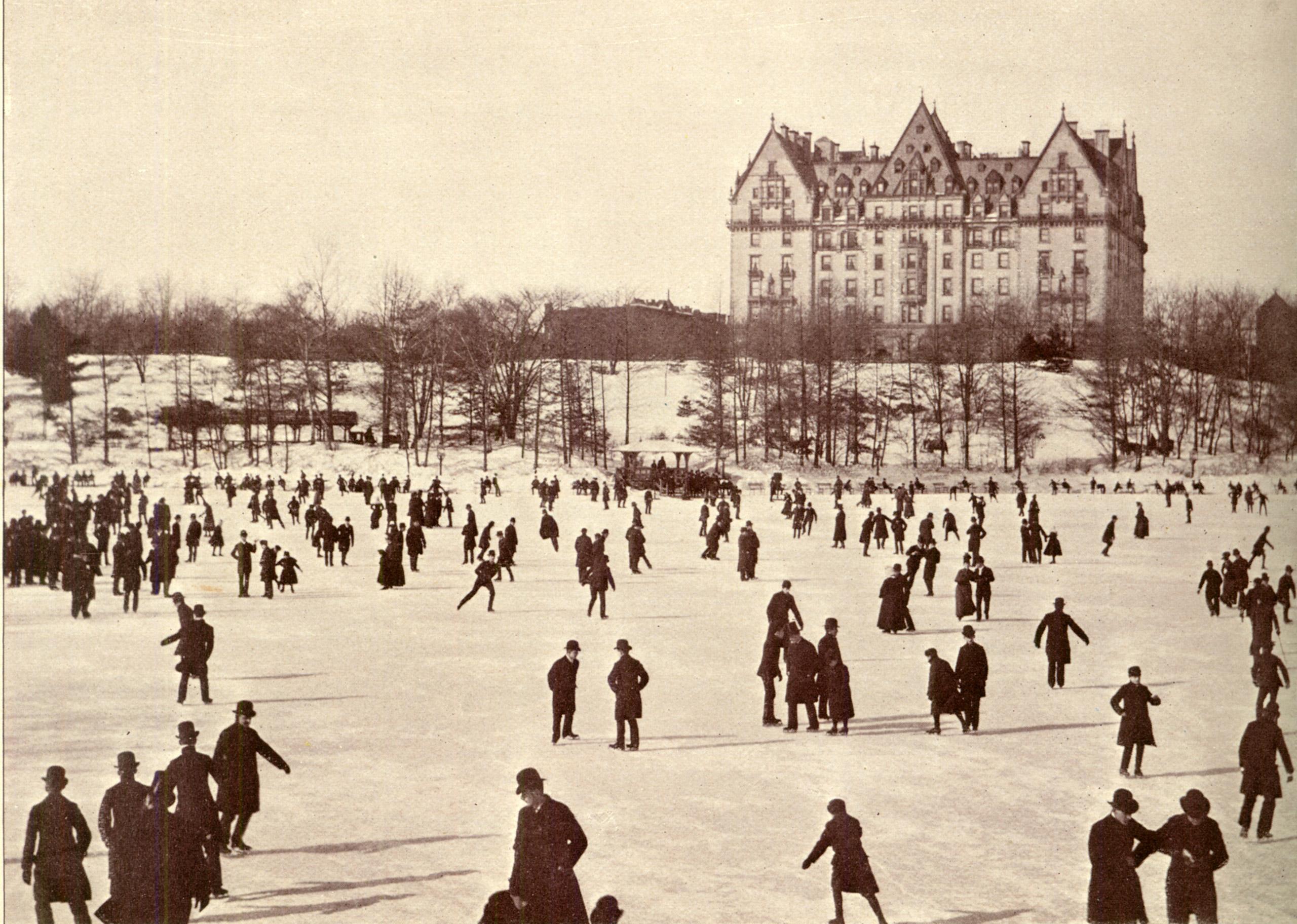 Skaters on the lake in Central Park. The Dakota dominated the scene.