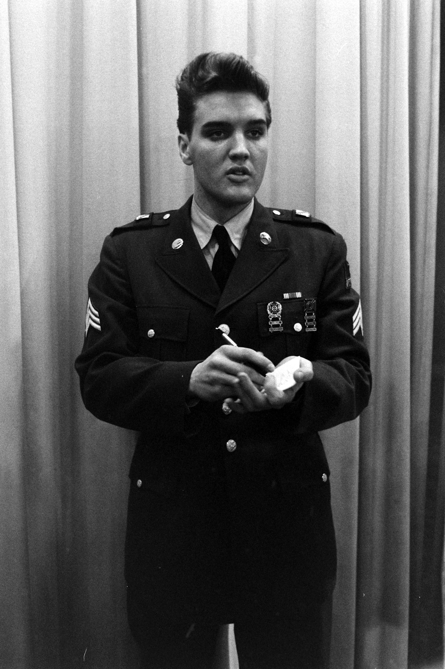 Dress up as Elvis Presley in his pre-jumpsuit days, pictured here at Fort Dix, New Jersey, shortly before his discharge from the U.S. Army in 1960.