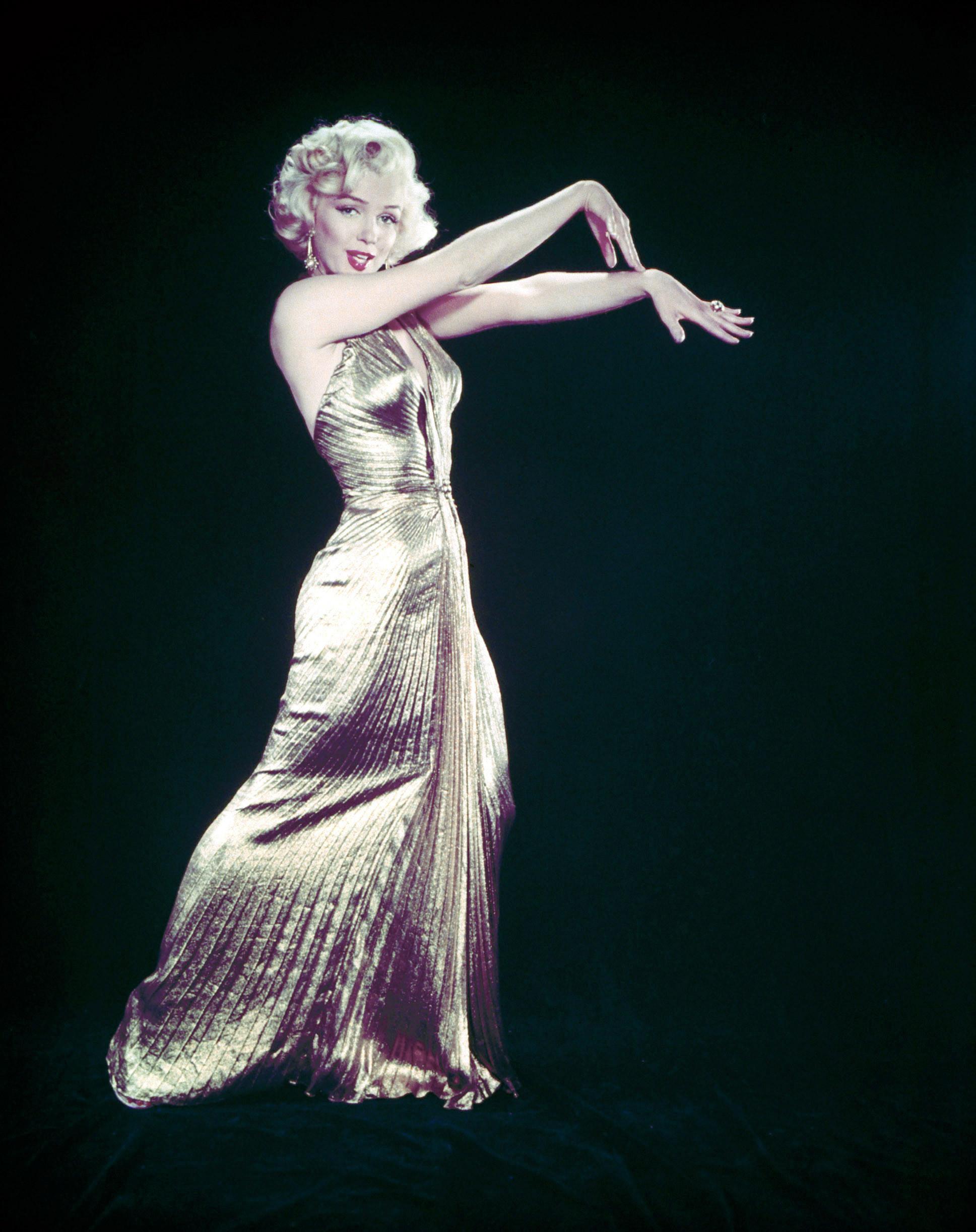 "Set aside the white halter dress in favor of Marilyn Monroe's gold lamé gown from the 1953 film""Gentlemen Prefer Blondes."""