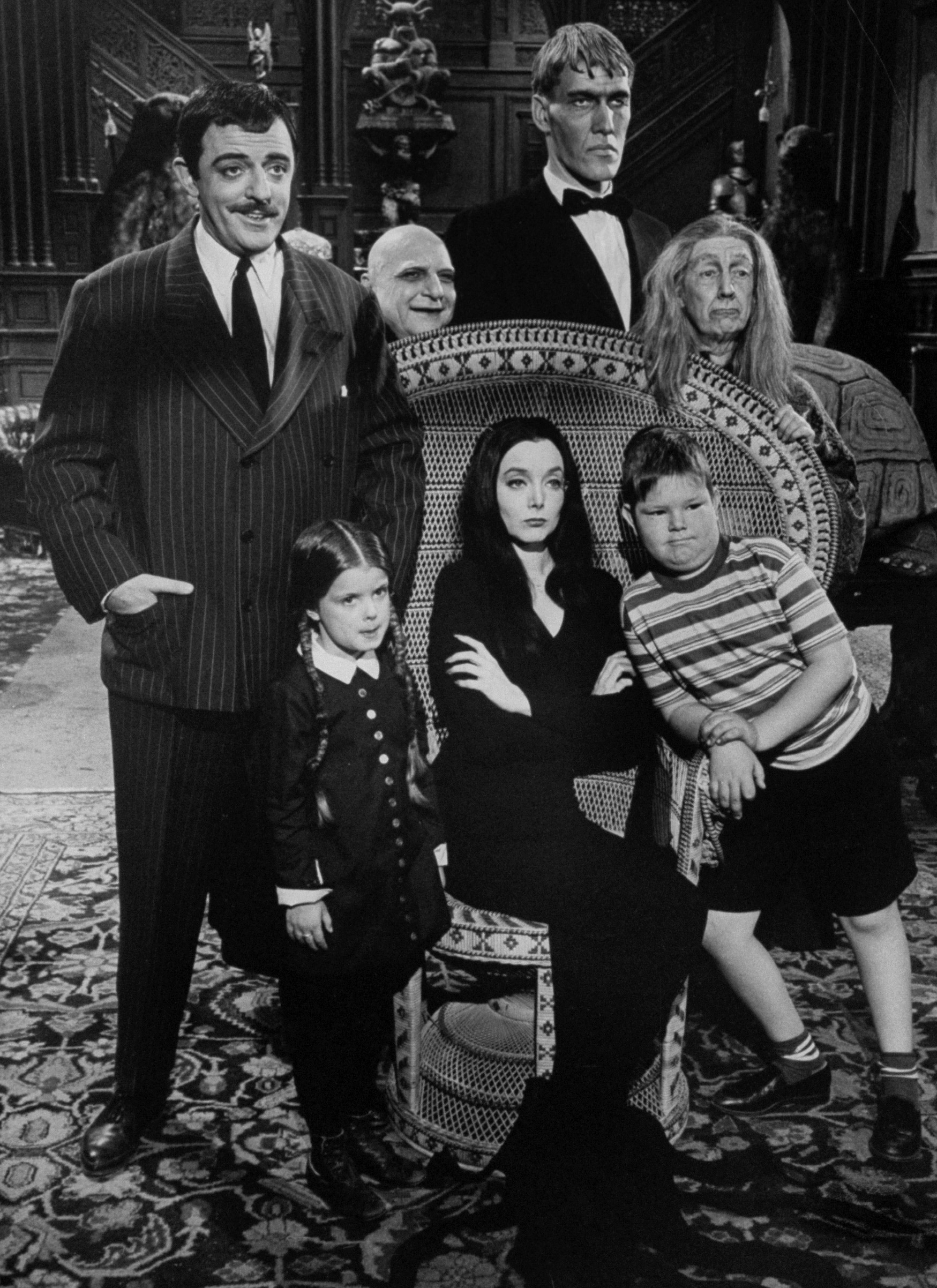 Find goth inspiration in the Addams Family, helmed by Carolyn Jones' Morticia and and John Astin's Gomez (pictured in 1964).