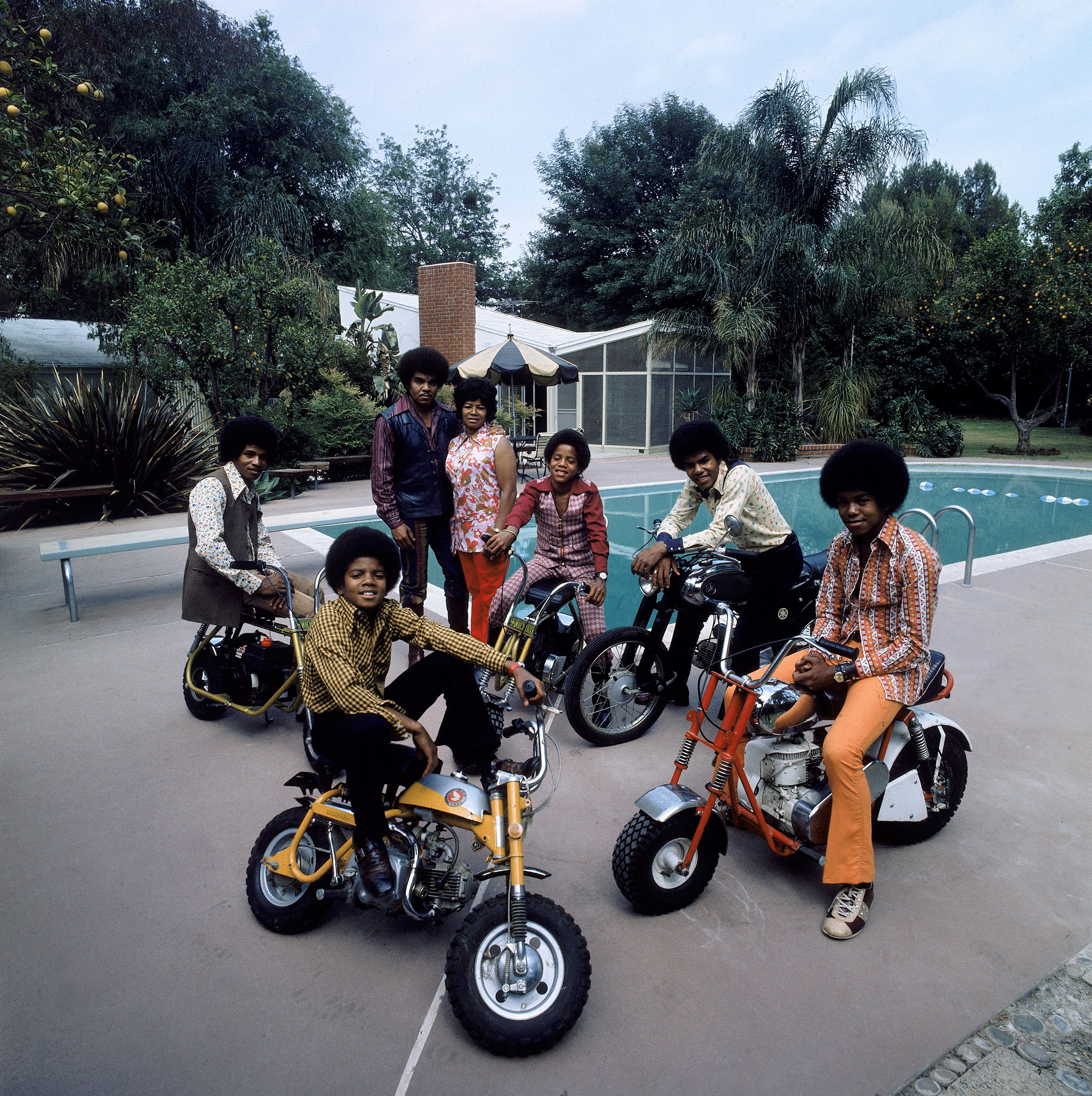 Make like the Jackson Five in 1970 with bellbottoms, ample polyester and a motorized scooter for trick-or-treating.