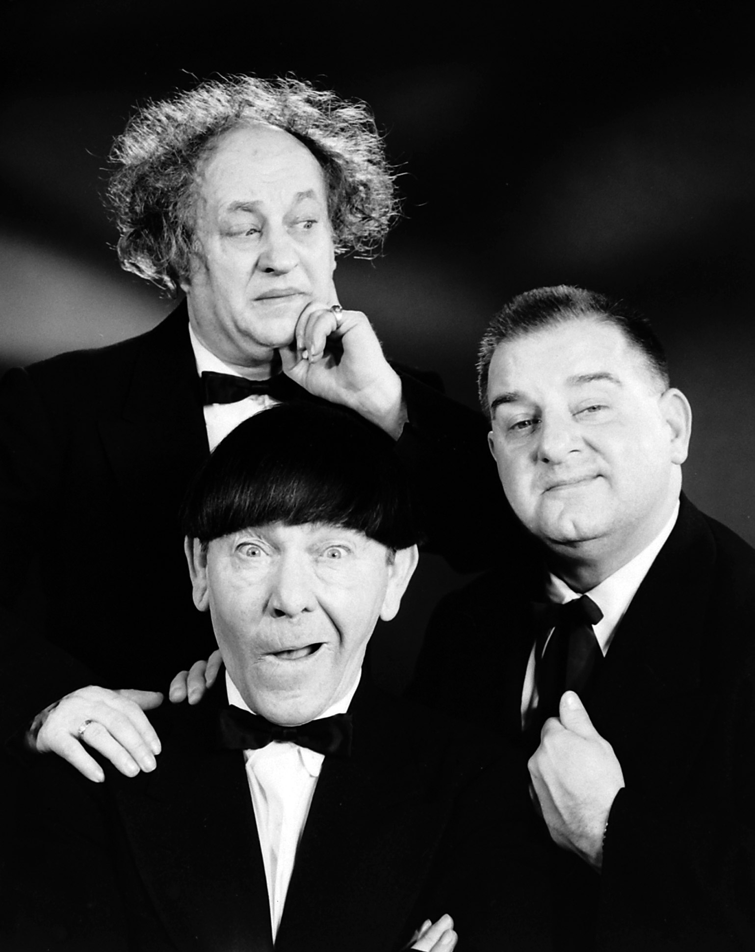 Practice hijinks with two friends and go as the Three Stooges (clockwise from left): Curly Joe DeRita, Moe Howard and Larry Fine, 1959.