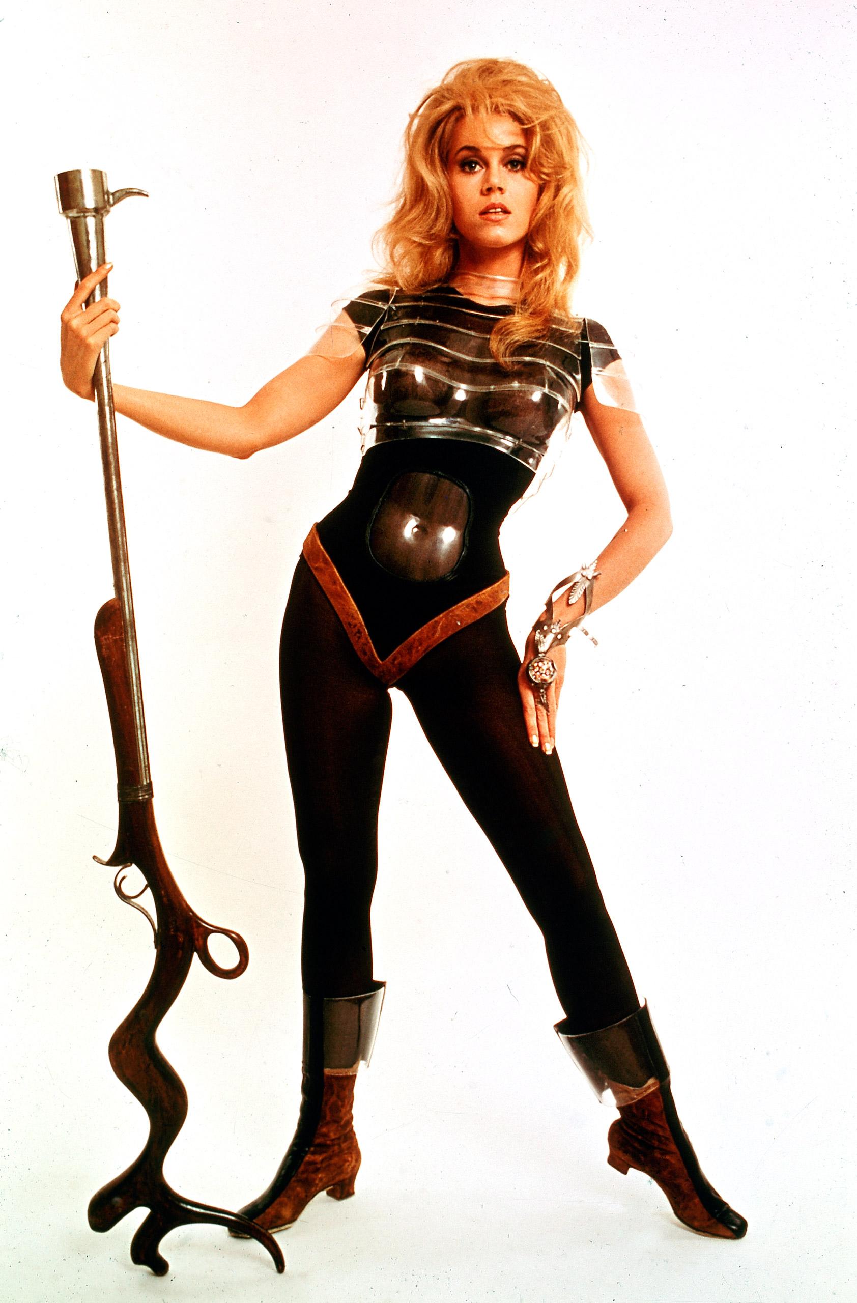 "Go as Jane Fonda in her ""Barbarella"" days (1967): big hair, futuristic bodysuit and Positronic Ray."