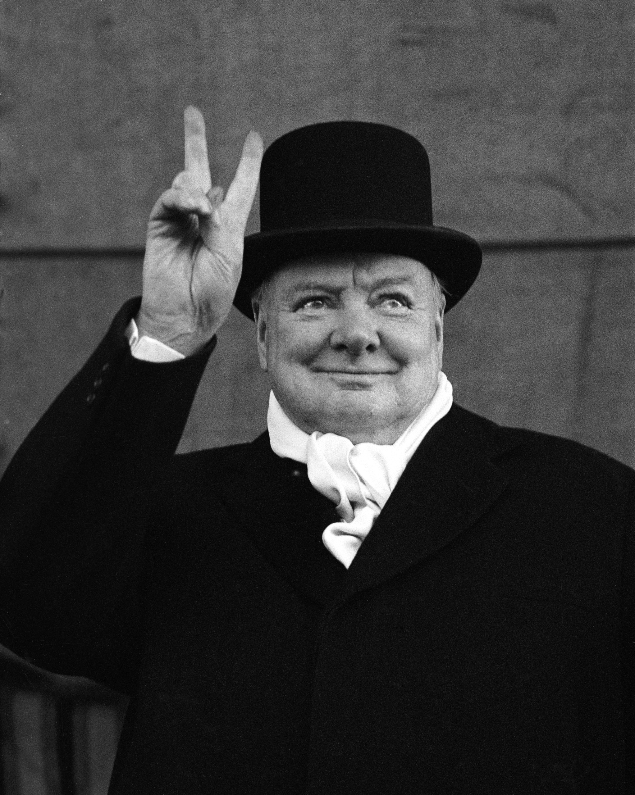 """If you can hold your fingers in a """"V for victory"""" sign all night, grab a top hat and white scarf to complete the look of Winston Churchill in 1951."""