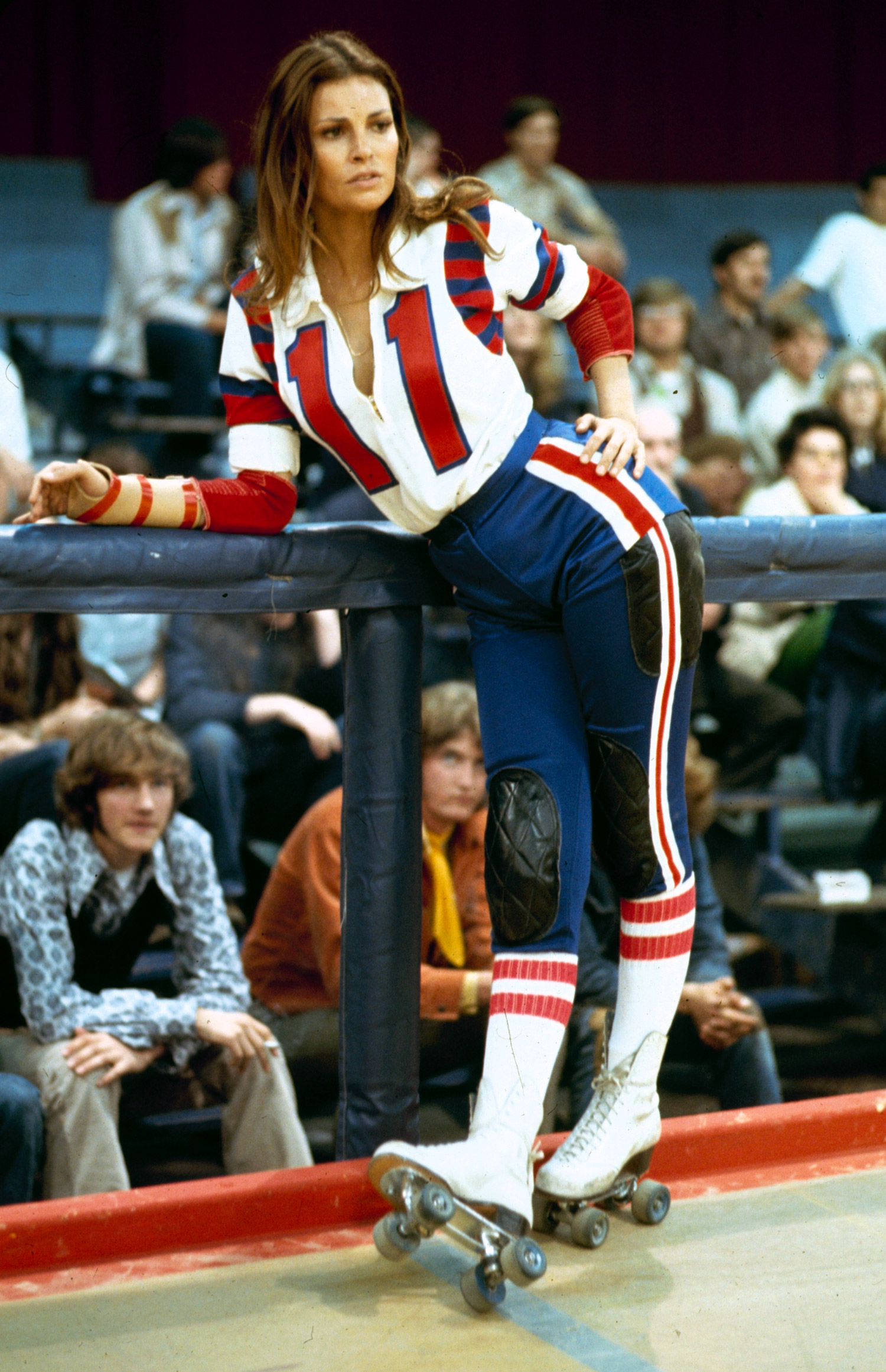 """Make like Raquel Welch in 1972's """"The Kansas City Bomber"""" by wearing a roller derby uniform and white lace-up skates."""