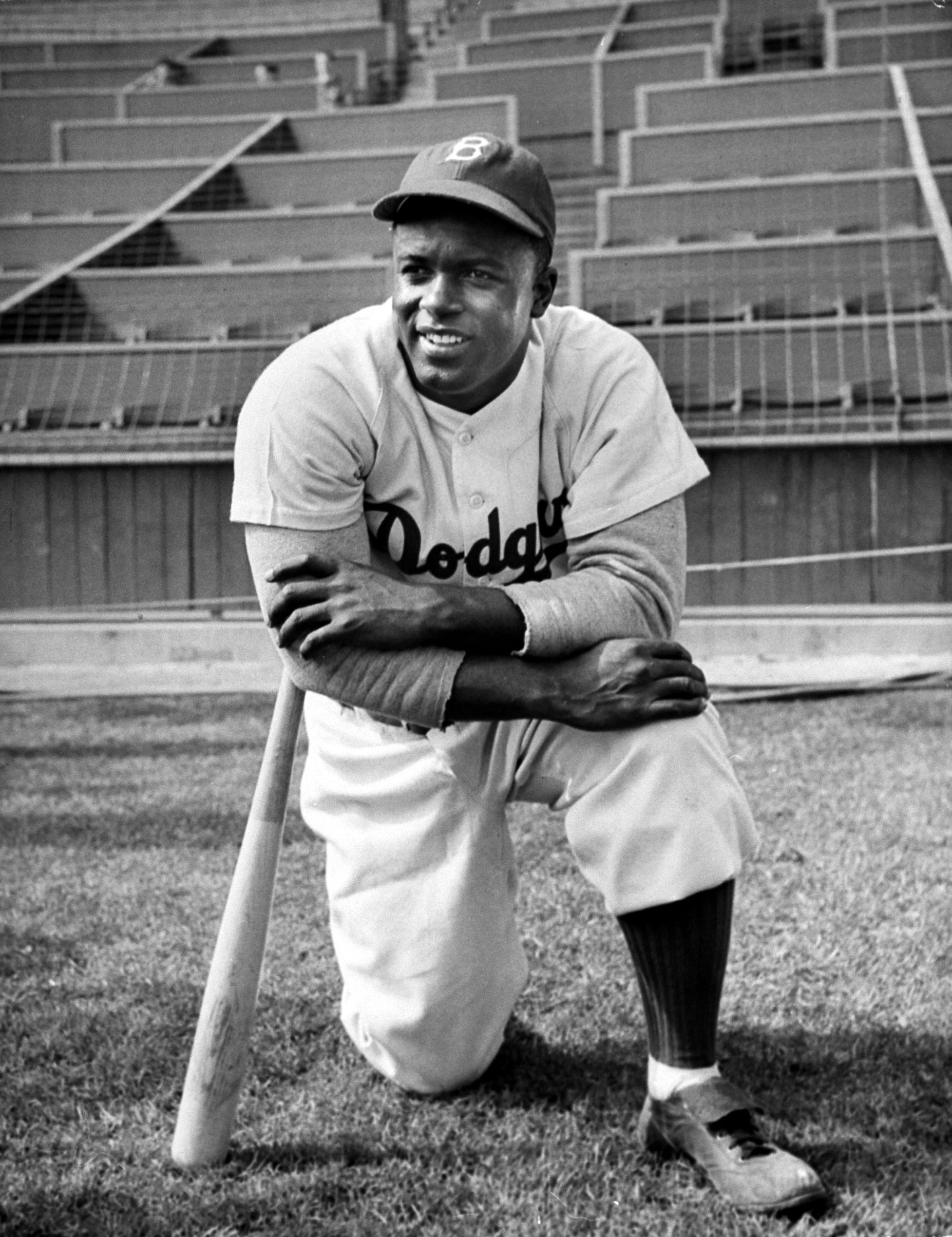 Buy an old-school Dodgers uniform--make sure it's number 42--to pay tribute to the great Jackie Robinson, pictured in 1950.