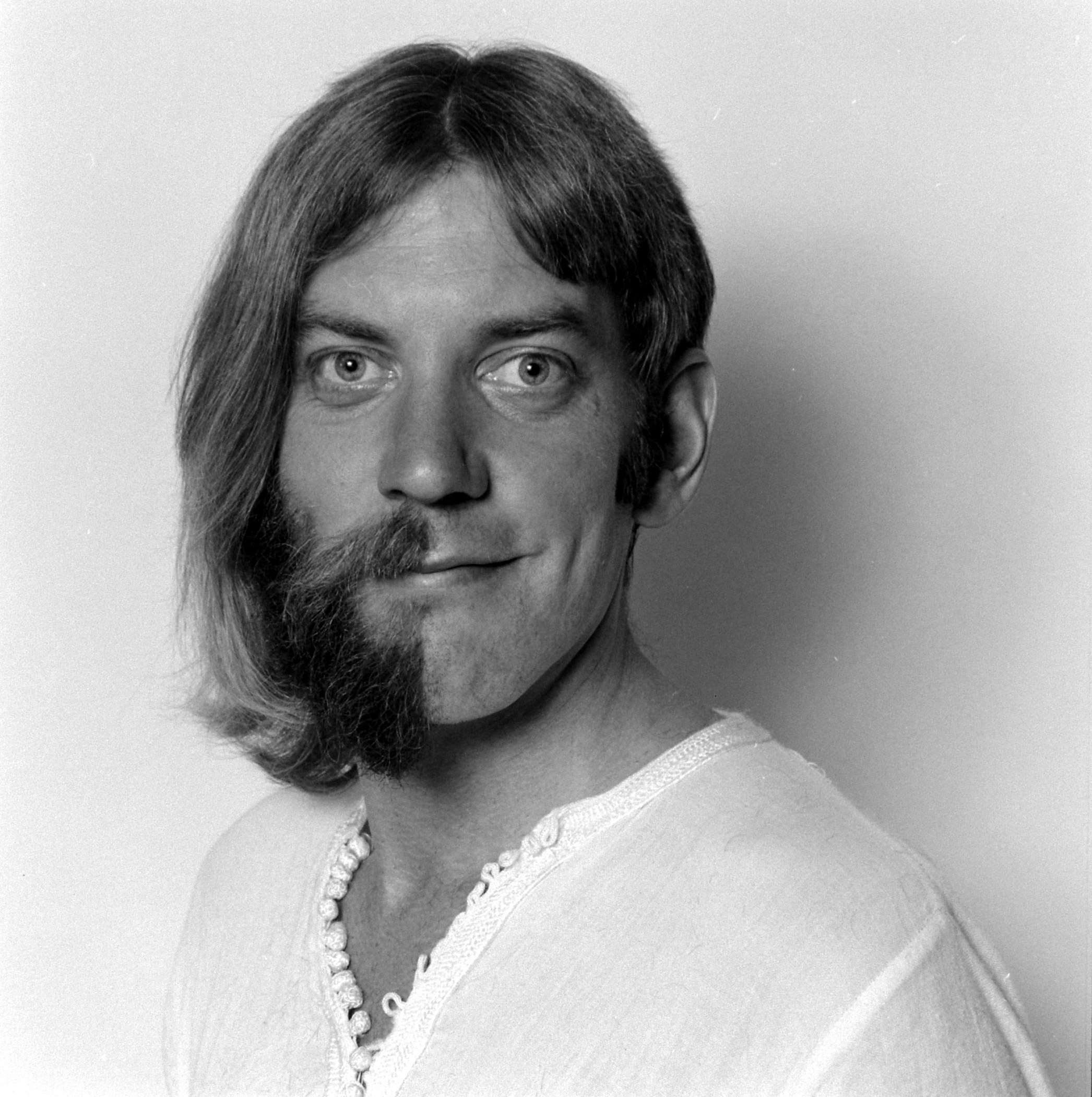 If you're looking to go from bearded to clean-shaven, go halfway for Halloween, as Donald Sutherland did in this classic 1970 portrait.