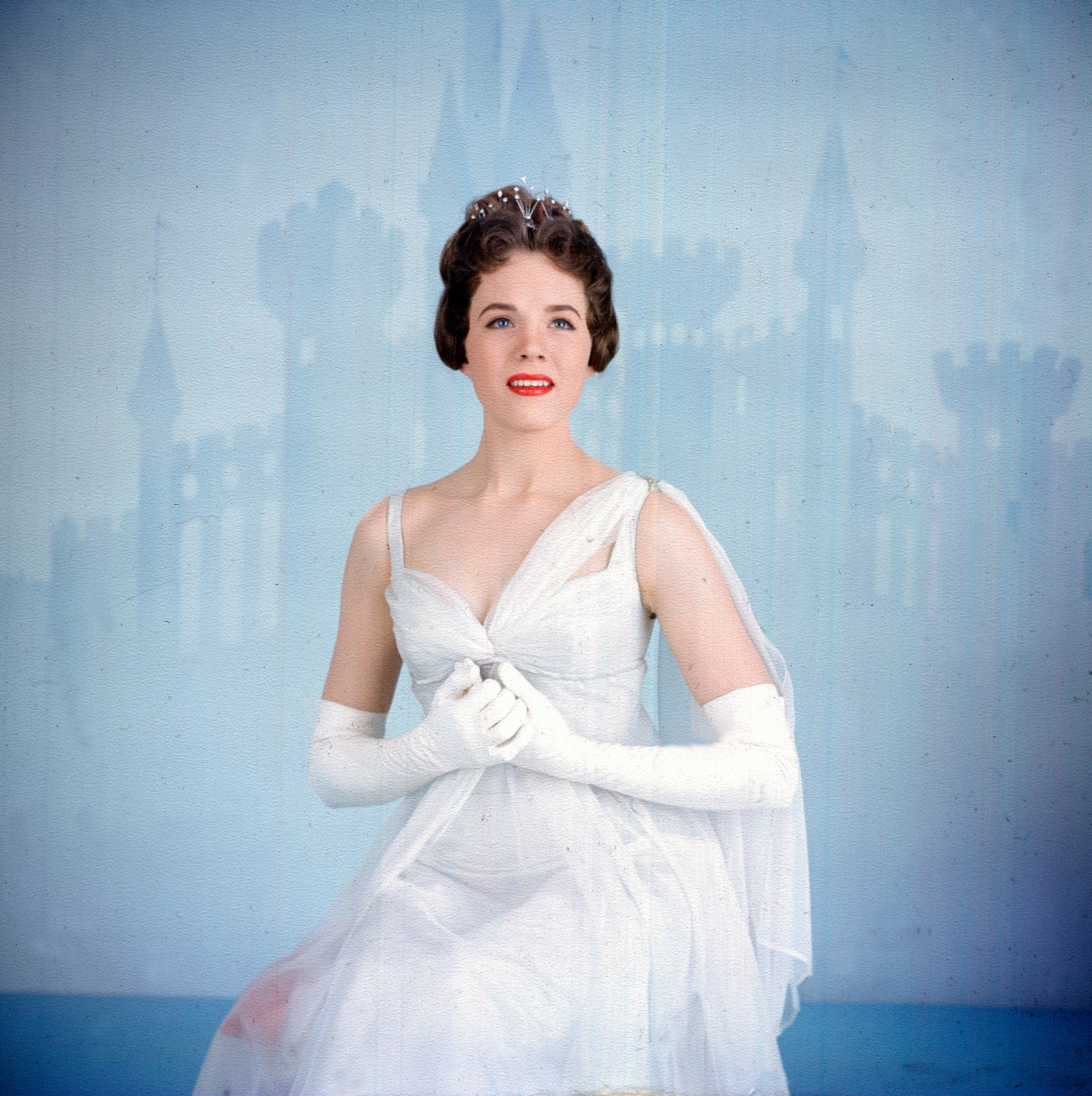 Dress as Cinderella à la Julie Andrews, in princess ball gown, tiara and white gloves for the 1957 live broadcast of the Rodgers and Hammerstein musical.