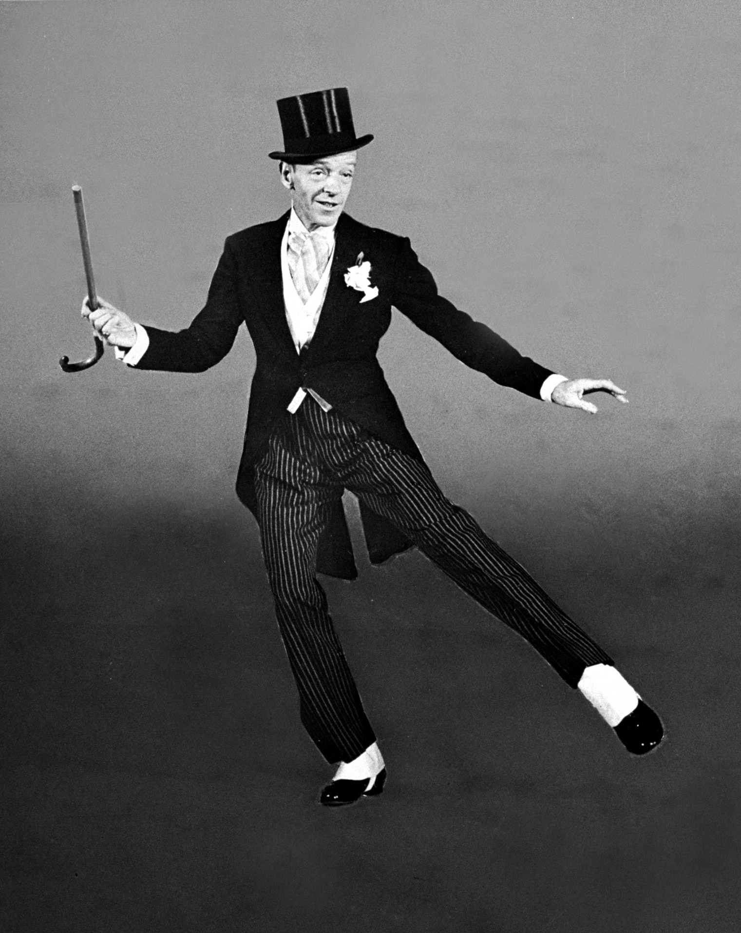 """Learn the words to """"Puttin' on the Ritz"""" and go full-on Fred Astaire with top hat, tails and spats and twirling cane (1945)."""