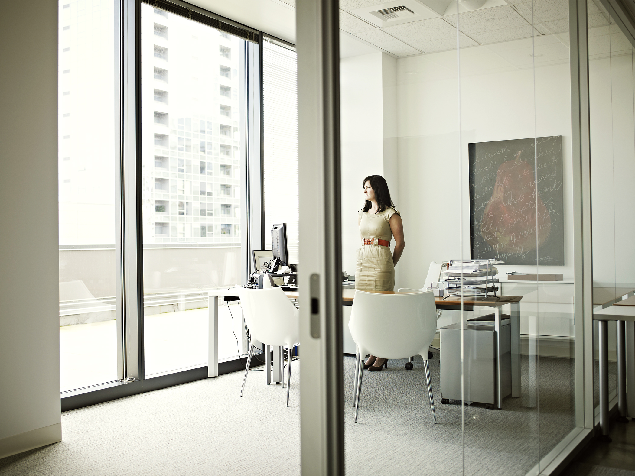 Businesswoman standing at desk in office
