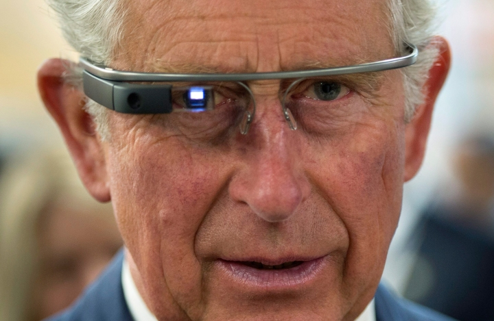 Prince Charles tries on Google Glass in Winnipeg on May 21, 2014.