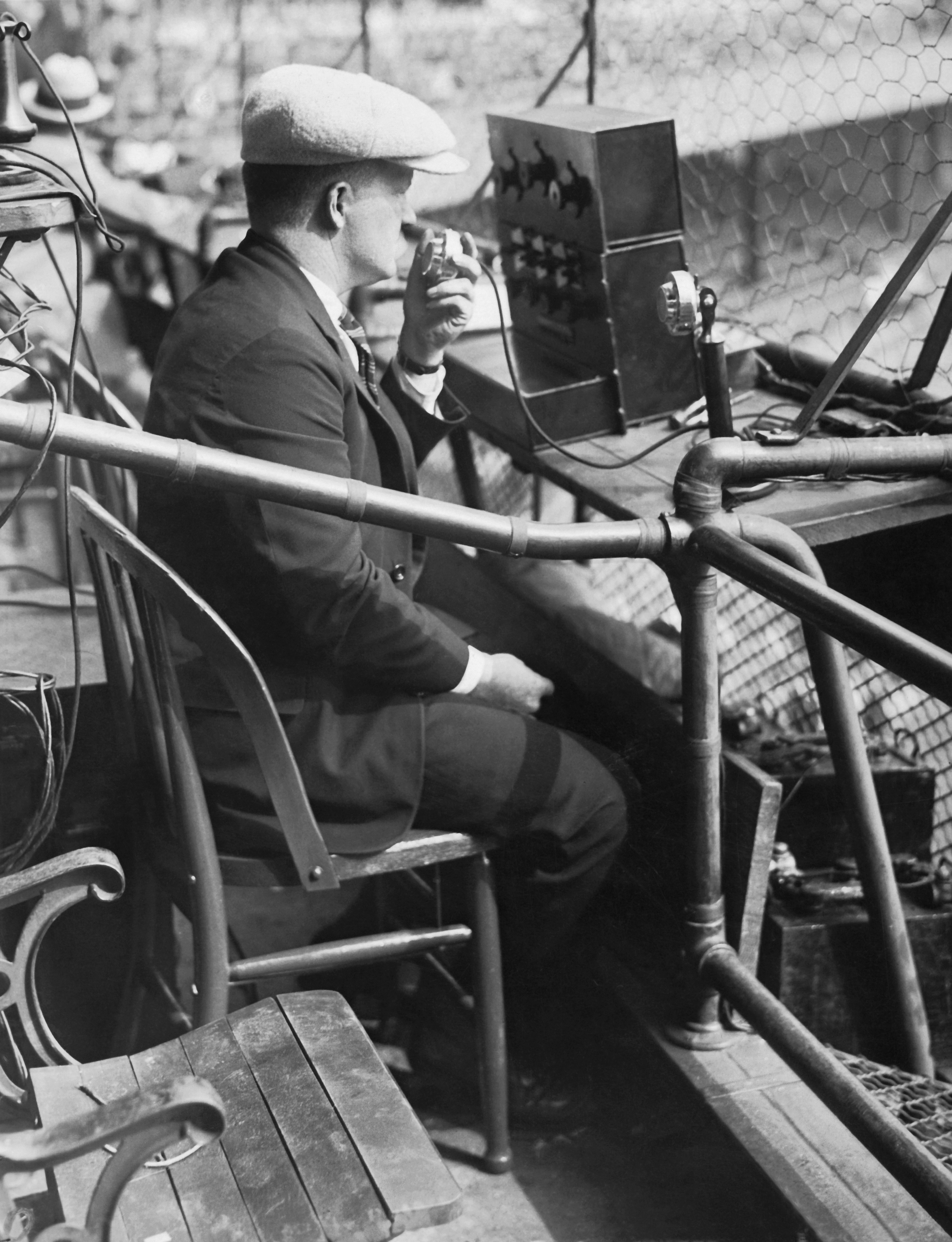 An AT&T engineer tests out an equipment for broadcasting the third game of the 1924 World Series at the Polo Grounds in New York City on Oct. 6, 1924.