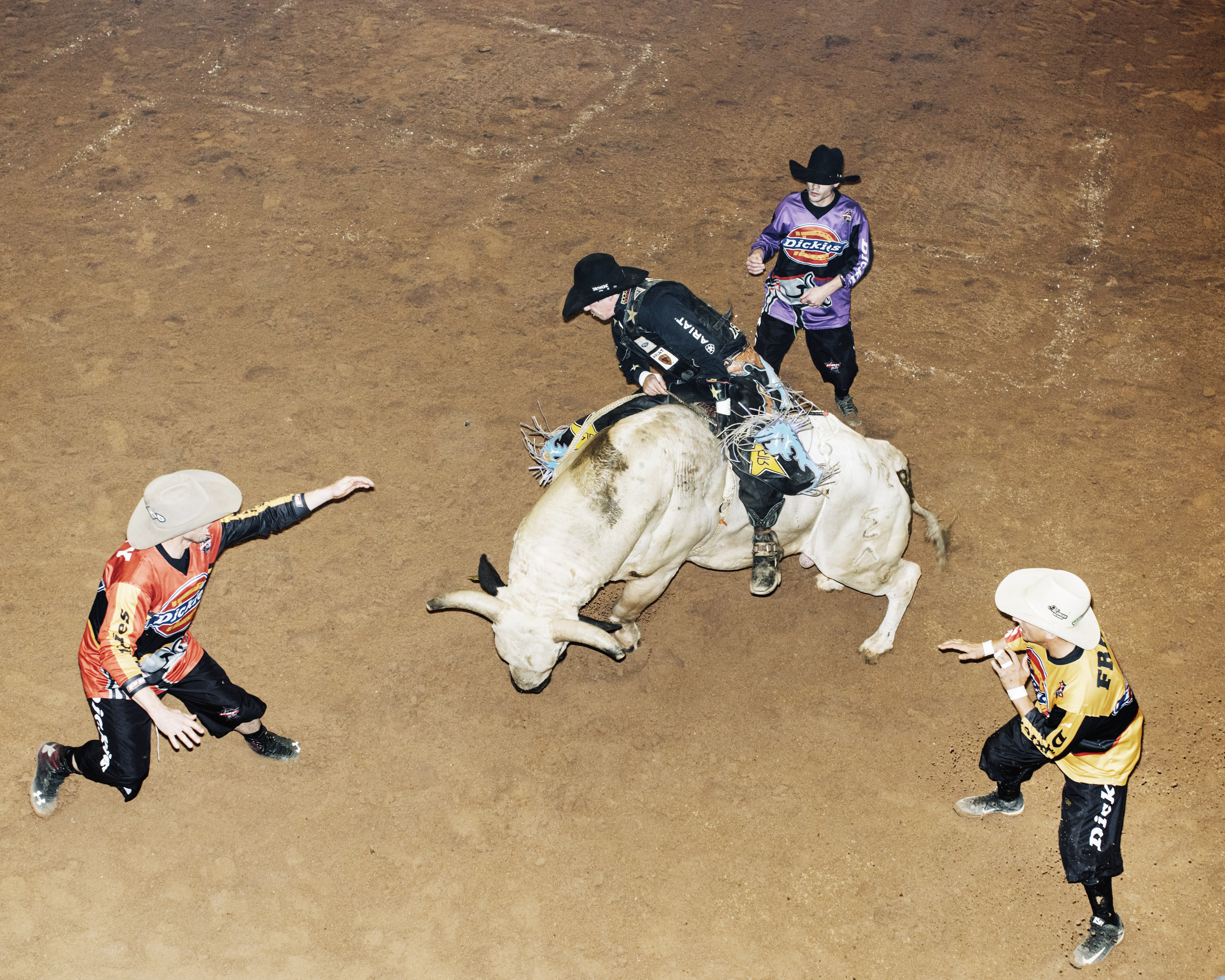 Three Bullfighters keep tabs on Bullrider Stormy wing at the Tucson Convention Center, Tucson, Arizona, Saturday, October, 3